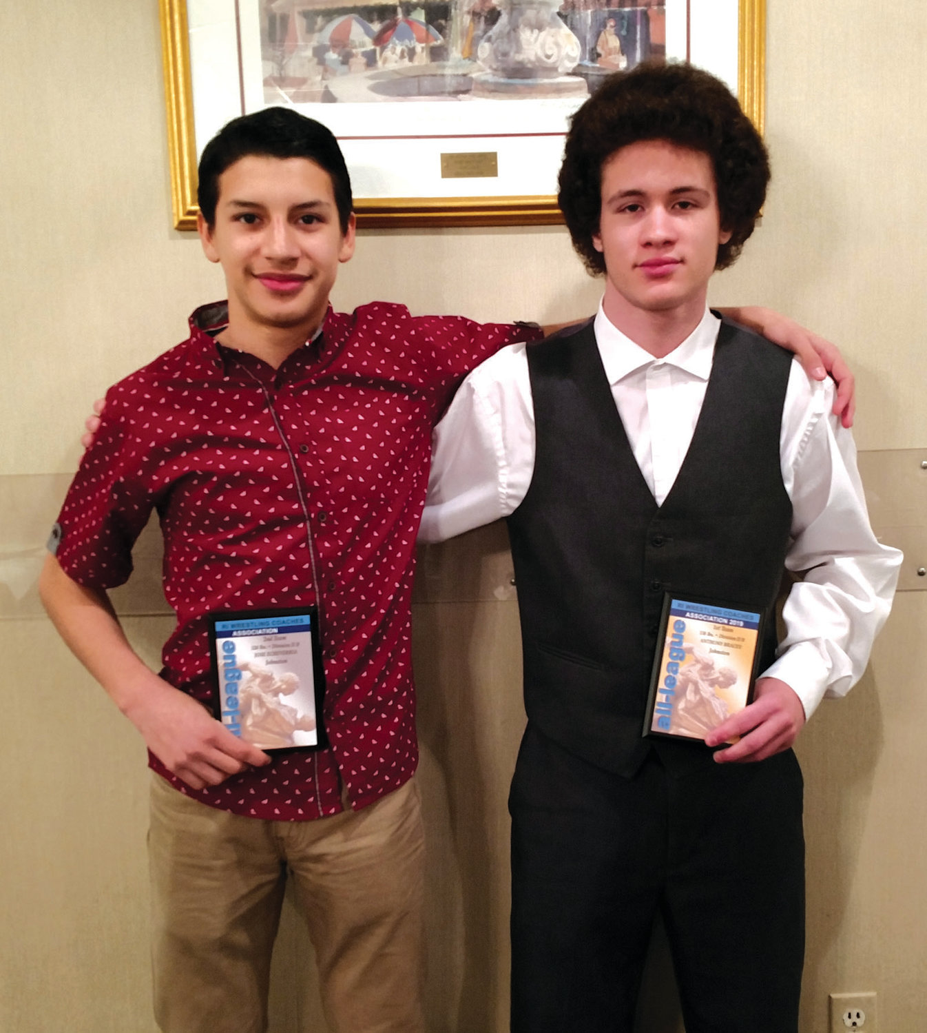 PROUD PANTHERS: Sophomore Joe Echeverria (left) and freshman Antonio Bracey recently received All-Division honors during the RI Wrestling Coaches Association Awards Dinner at Wright's Farm in Burrillville.