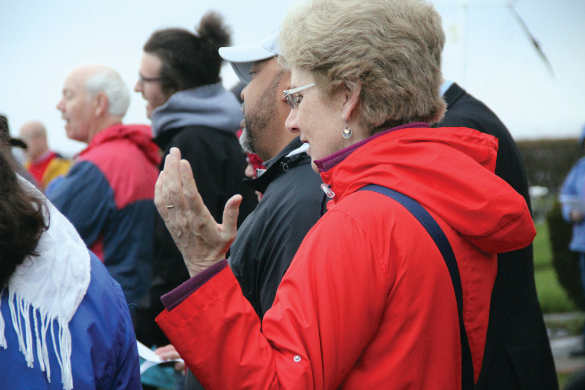 FEELING THE POWER: Earlier risers found the power of the word in services at Warwick Light overlooking Narragansett Bay.