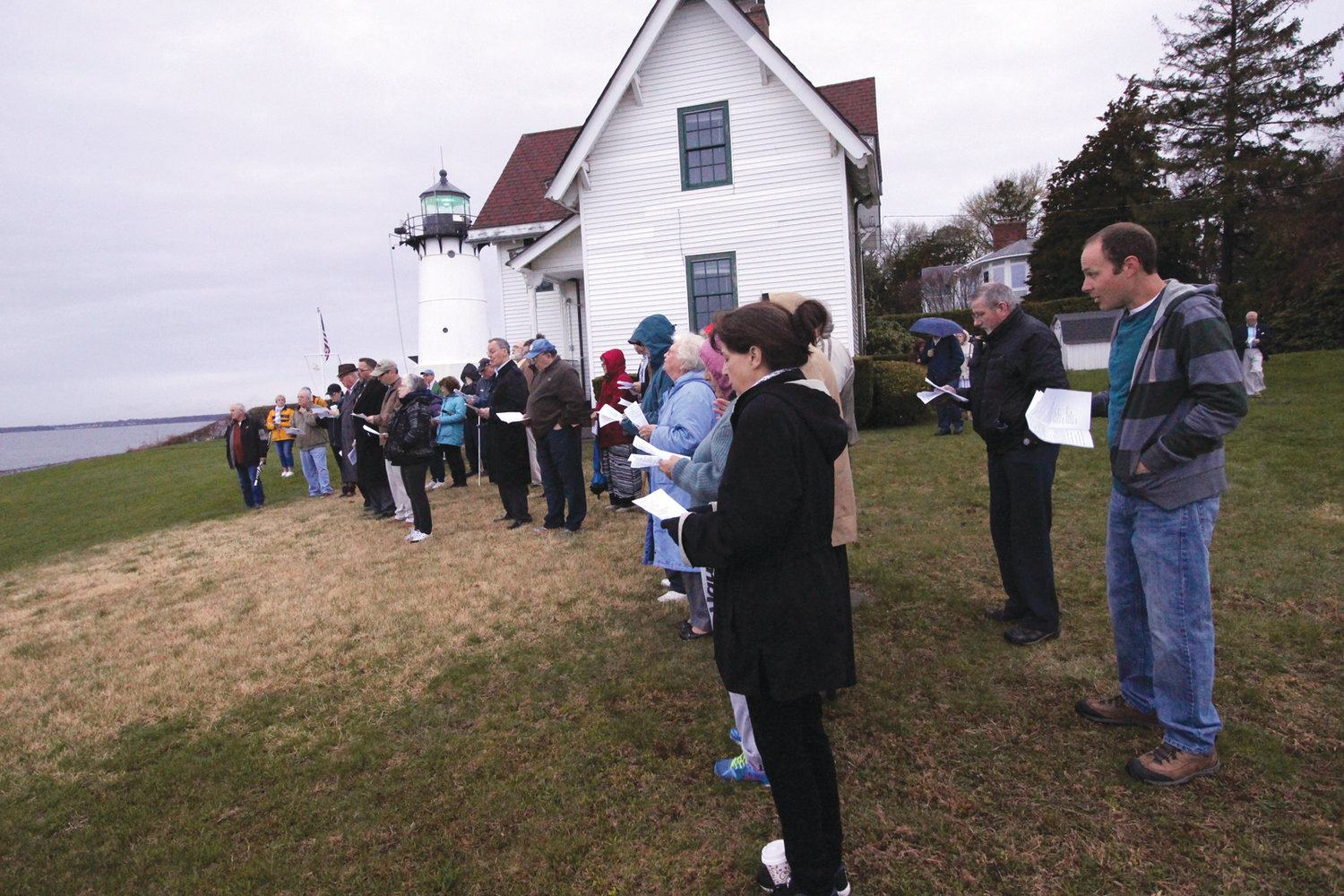 NO SUN…AND NO RAIN: Worshipers were blessed with warm weather and no rain at Easter sunrise services at Warwick Neck Light.