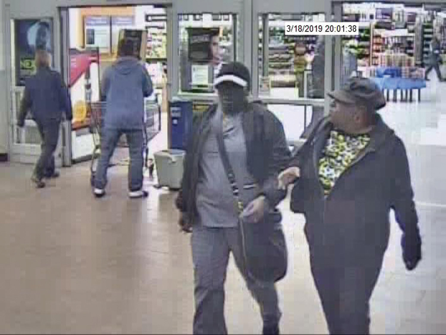 WALMART THEFT: Police are seeking two subjects, seen in this image taken from security footage, in the theft of more than $4,000 from a Walmart cash register on March 18.