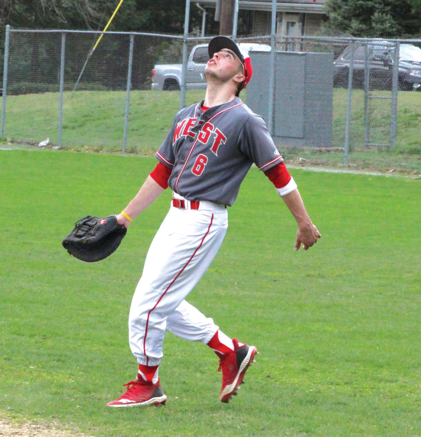 PLAYING THE FIELD: Cranston West first baseman Evan Smith tracks a fly ball last week against Johnston.