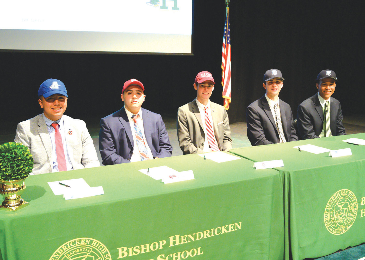 NEXT LEVEL: Five Bishop Hendricken athletes signed their National Letters of Intent on Tuesday. They are from left: Max Paolino, Ryan Morel, Aidan Tierney, Russell White and Duwaun Edwards.