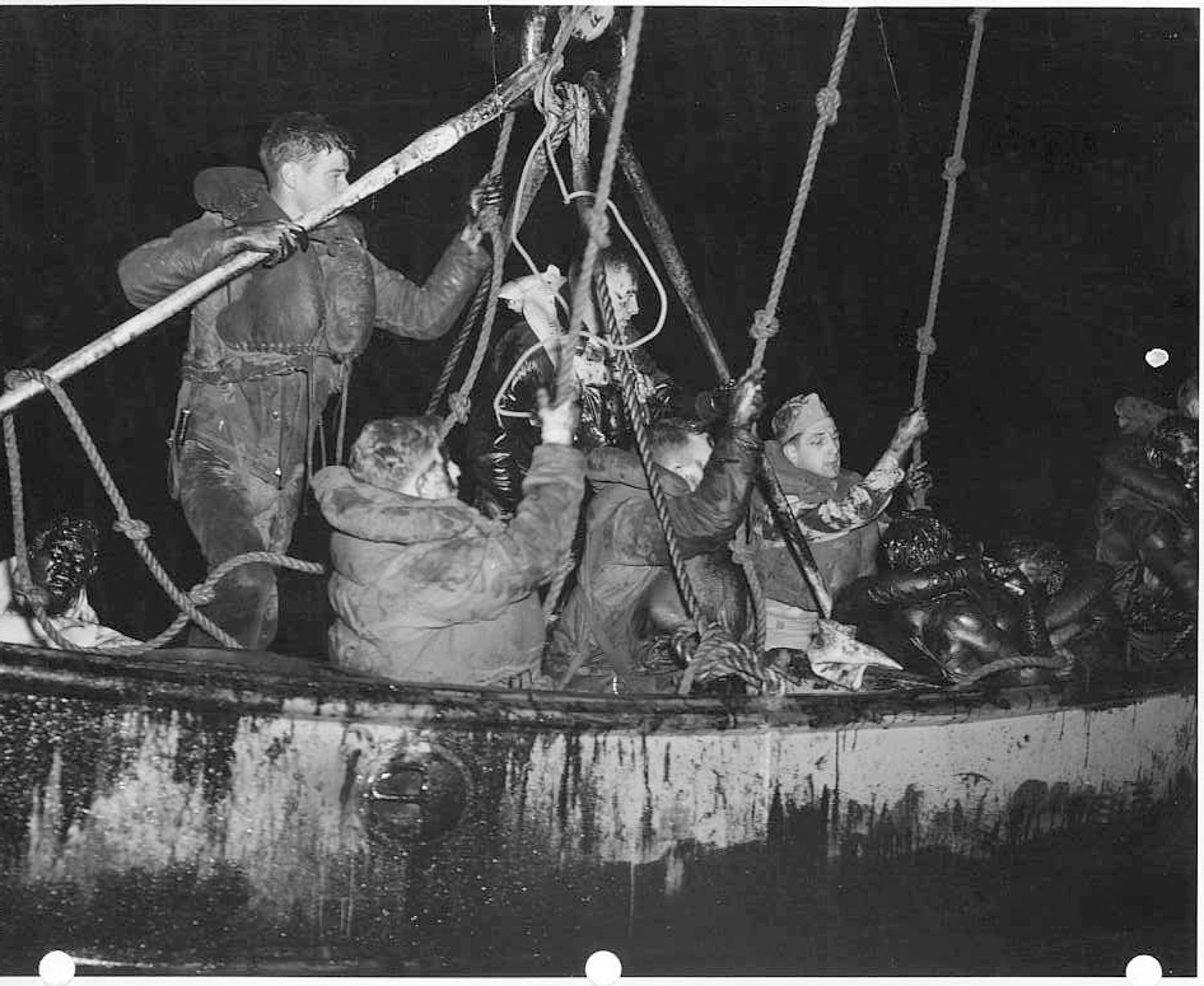 Survivors being pulled from the oil-slicked sea the night of the collision.