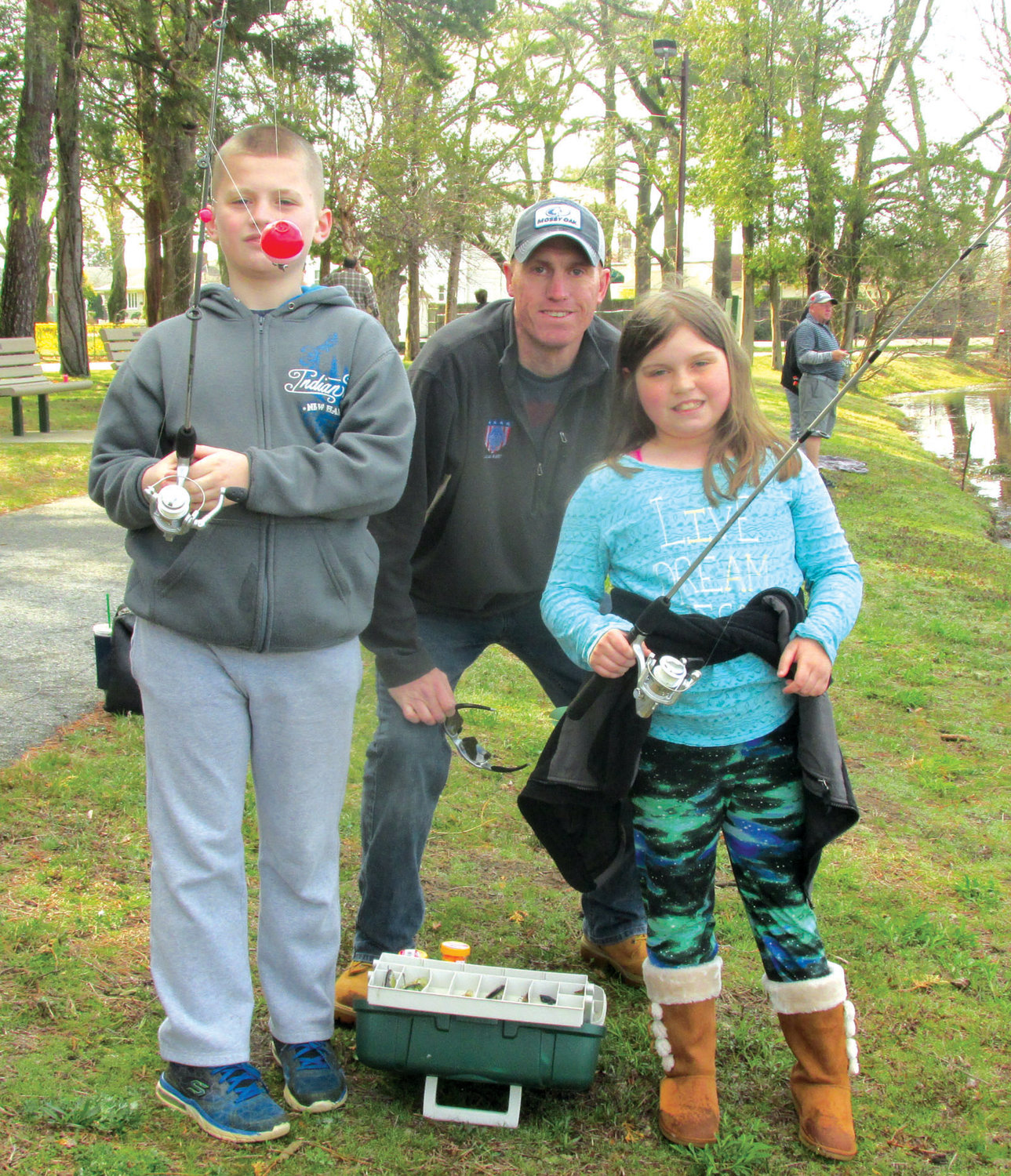 TROUT TREK: This scene will be commonplace Saturday when the Johnston Parks & Recreation Department holds its annual Youth Fish Derby inside War Memorial Park. Youngsters ages 4-12 are eligible to fish.