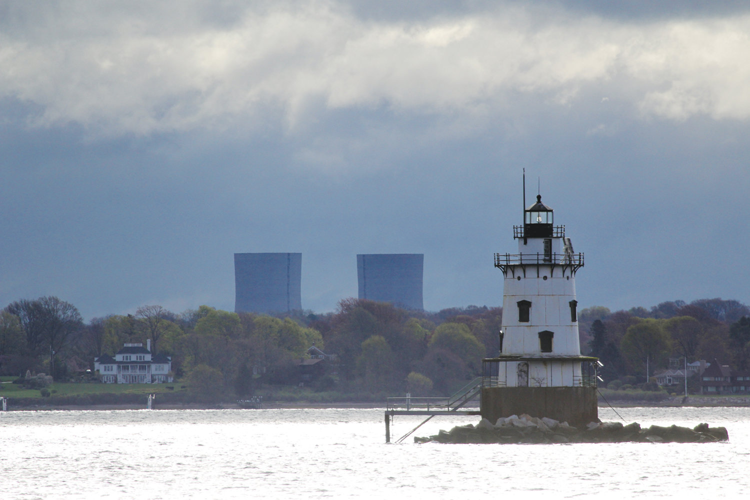 HERE NOW, GONE IN SECONDS: These photos by Ginny McGovern show the towers as seen from Conimicut Point before and as they came down.
