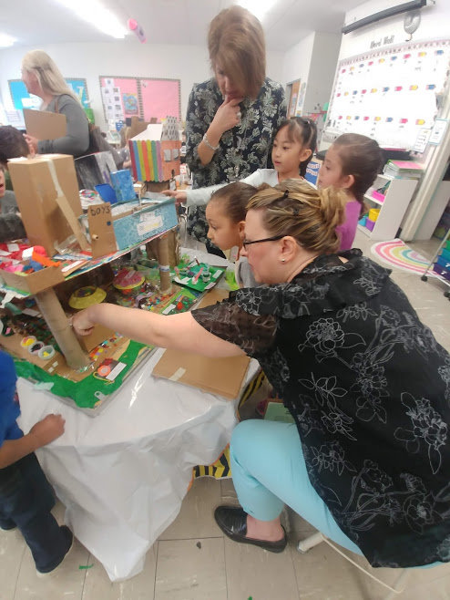 TAKING A TOUR: Special guests visited the kindergarten classrooms at Glen Hills last week as they showcased their final Governor's Projects. Here, the students in Maria Santonastaso's classroom give Susan Marchetti and Stephanie DiChiro a tour of their Kid's Library.
