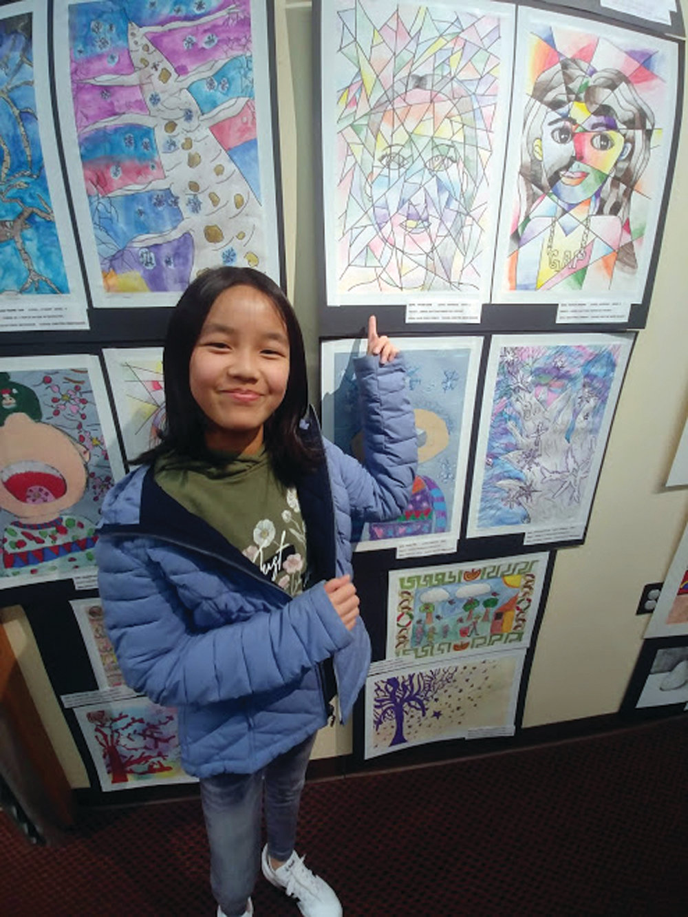 REPRESENTING WOODRIDGE: Tiffany Chen, a fifth-grader from Woodridge Elementary School, proudly showed off her artwork to friends and family.