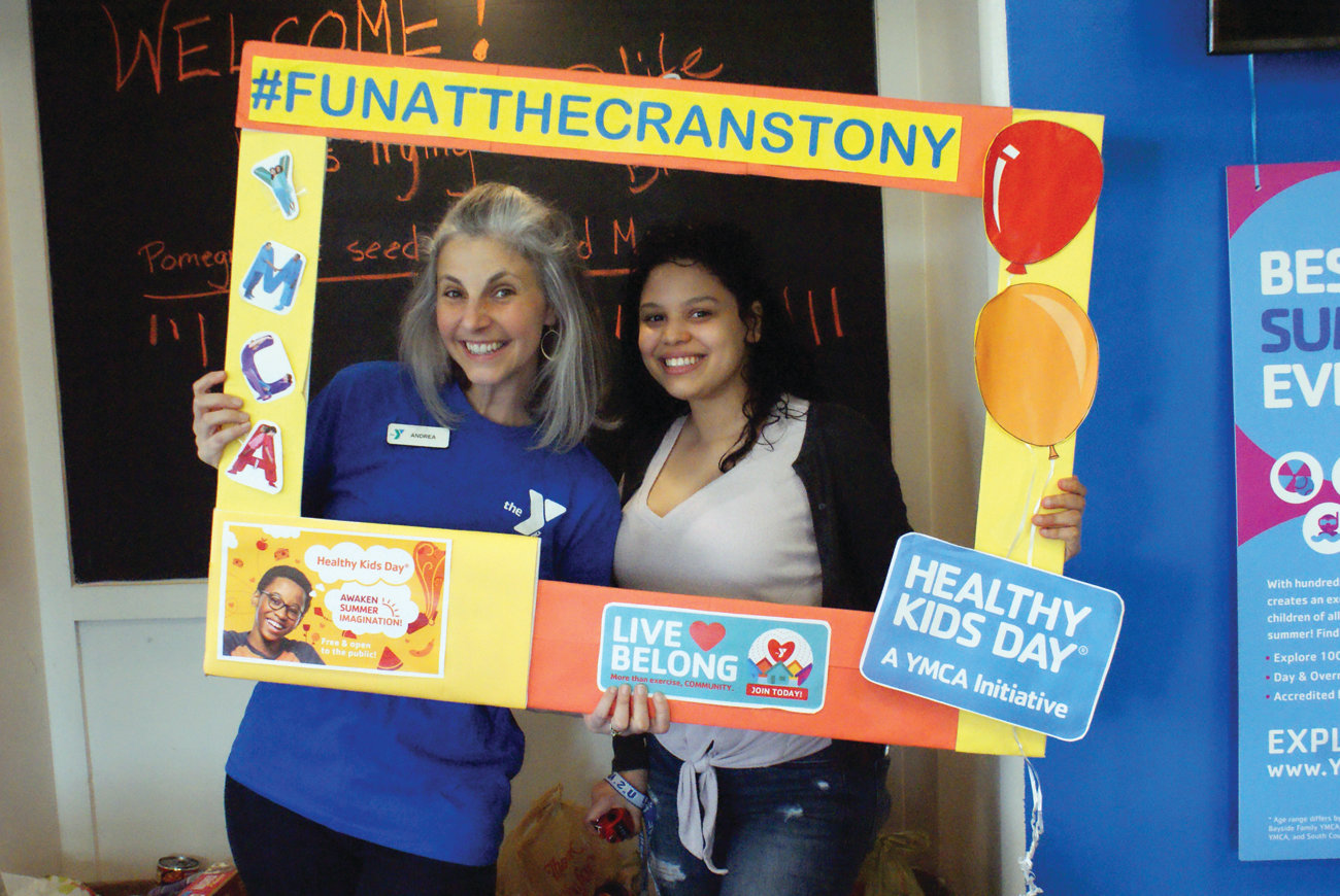FUN TIME: Andrea Champagne, executive director of the Cranston YMCA, was on hand with volunteer Fatima Medina during the Healthy Kids Day event.