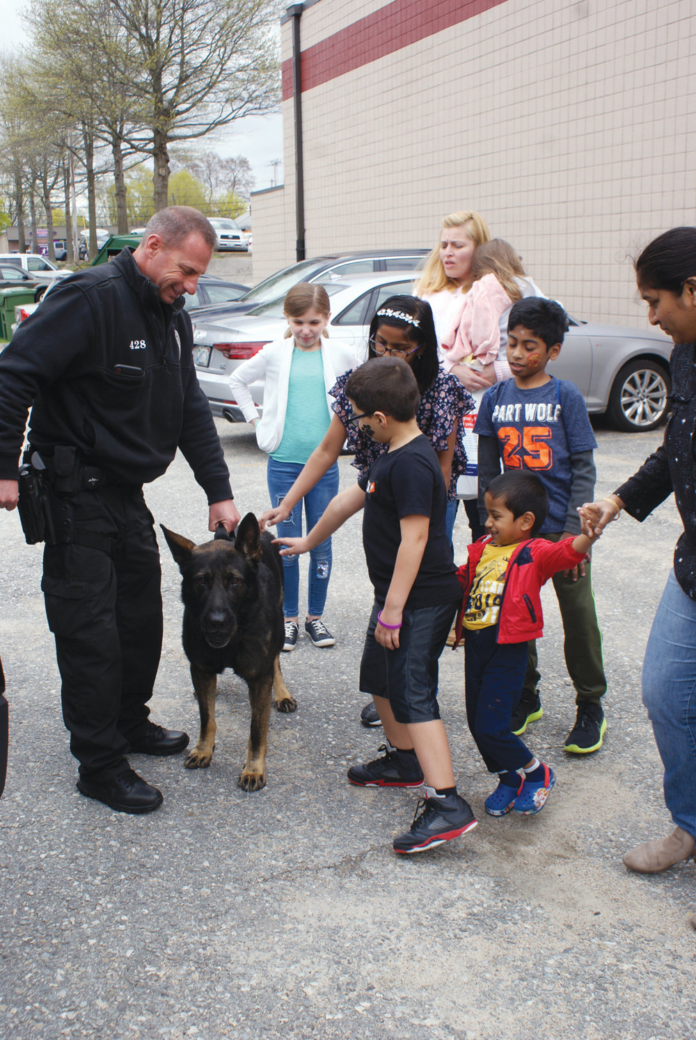 MEETING BLESK: Children who attended Healthy Kids Day at the Cranston YMCA enjoyed getting to know Cranston Police K-9 Blesk and his partner, Officer Shane O'Donnell.