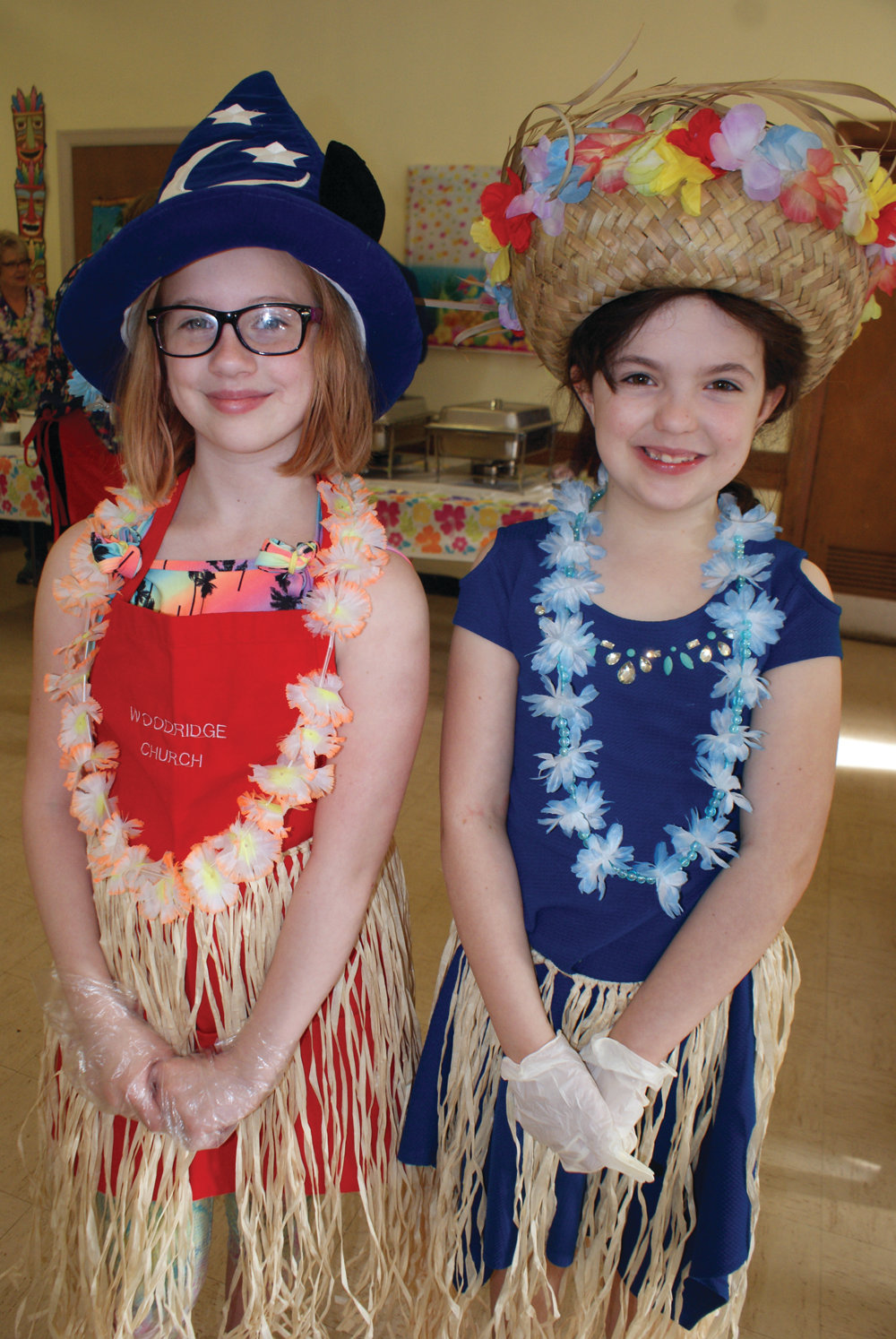 YOUNG VOUNTEERS: Samantha Handrich, 10, and Rachael Pine, 9, volunteered at the Almost May Breakfast. Samantha helped to distribute waffles and Rachael pitched in at the muffin table.