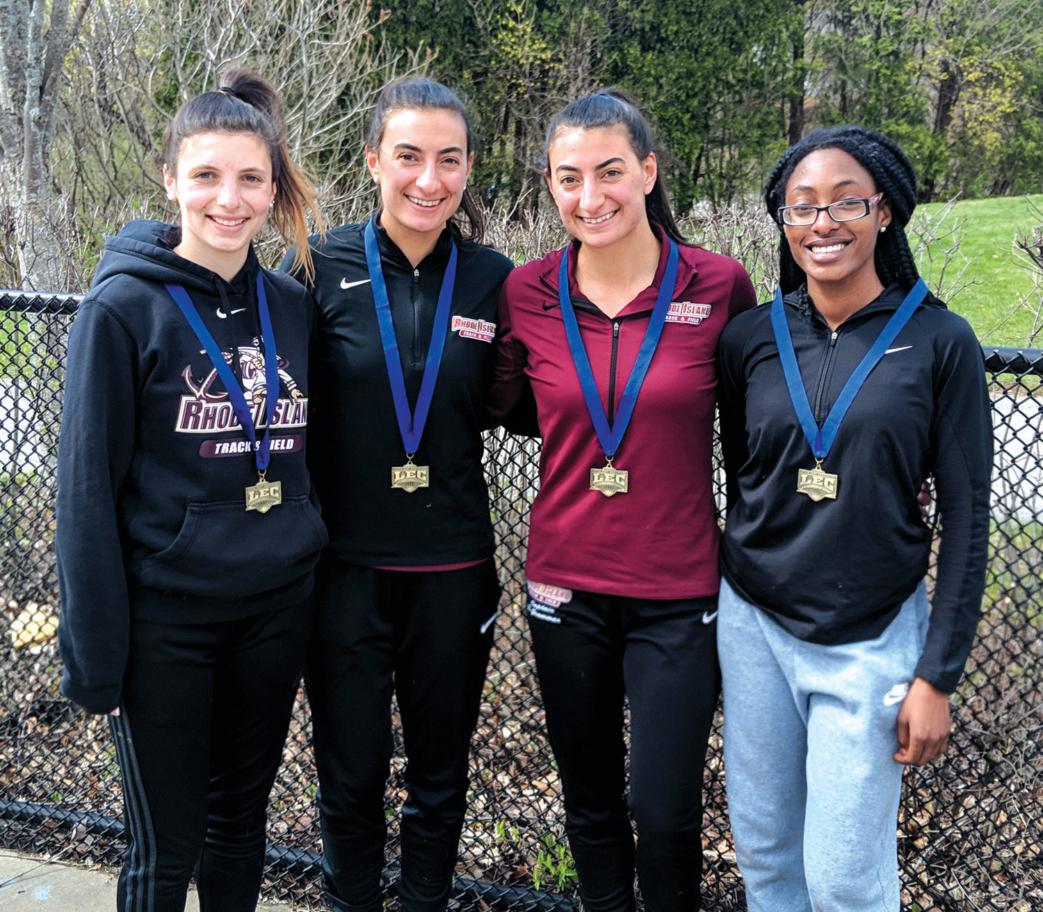 SUPER SQUAD: Emma Landroche, Nicole Grammas, Eleni Grammas and Tiffany Hayes combined their talents and won the 4x400m relay in 4:02.30 to help the Rhode Island College Anchorwomen win the prestigious New England Women's Track Alliance and Little East Conference championships last weekend in Fitchburg, Ma.