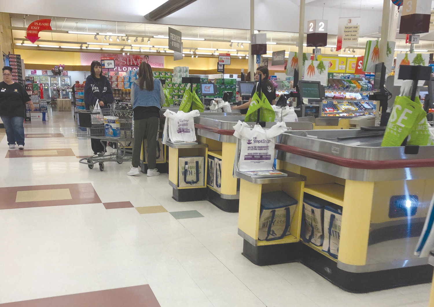 HERE TO STAY: Customers load their plastic bags into a cart at the Stop & Shop on Atwood Avenue in Johnston on Tuesday. Mayor Joseph Polisena said the town does not have an appetite to ban such single-use plastic bags as other towns and cities have around the state.