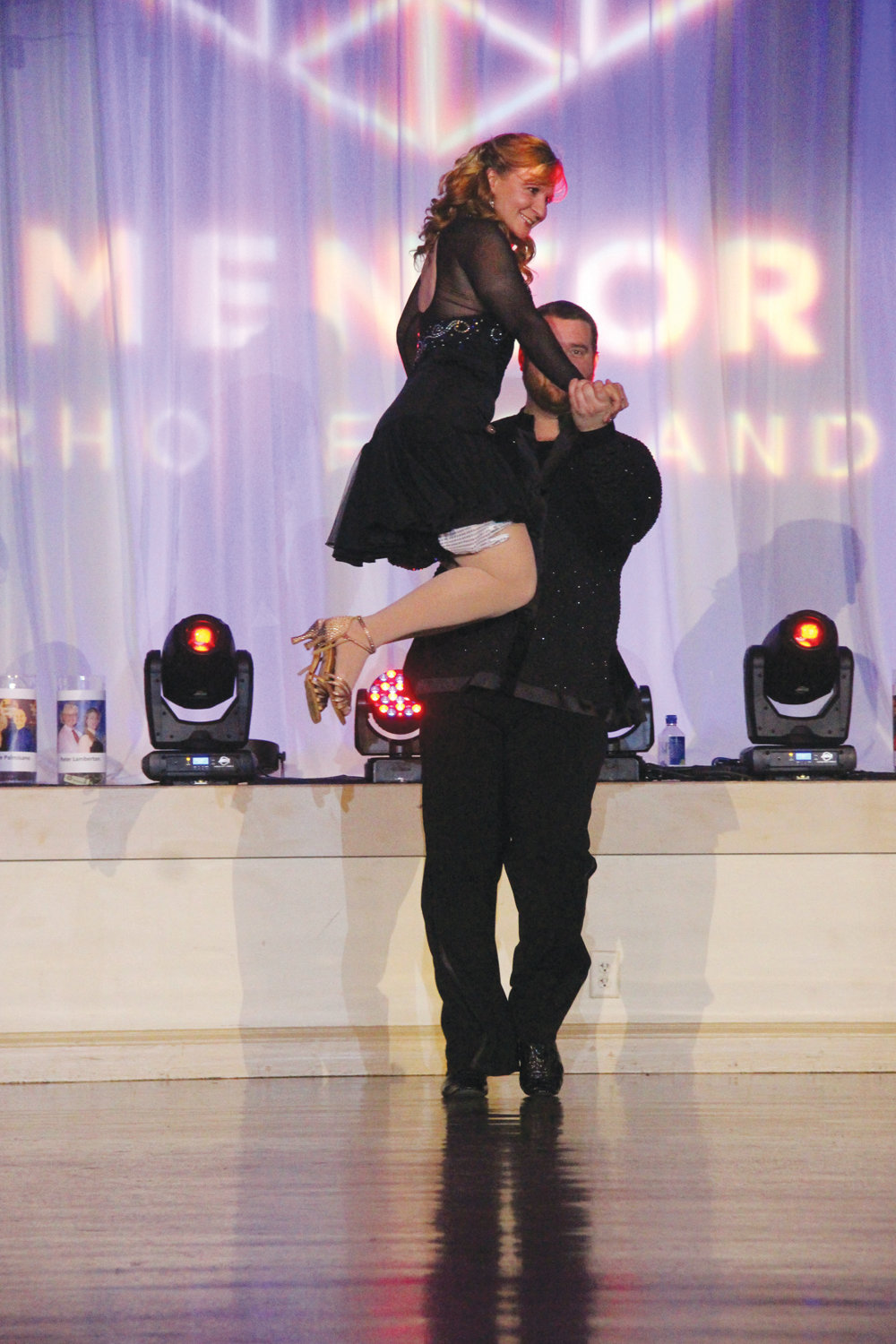 STAR-STUDDED EVENT: Ten amateurs and their mentors from The Dancing Feeling – including Barbara Ann Fenton, wife of Cranston Mayor Allan Fung, seen above leaping into the arms of Noah Carsten – took to the floor of Rhodes on the Pawtuxet in May for the 13th annual Dancing with the Stars of Mentoring.