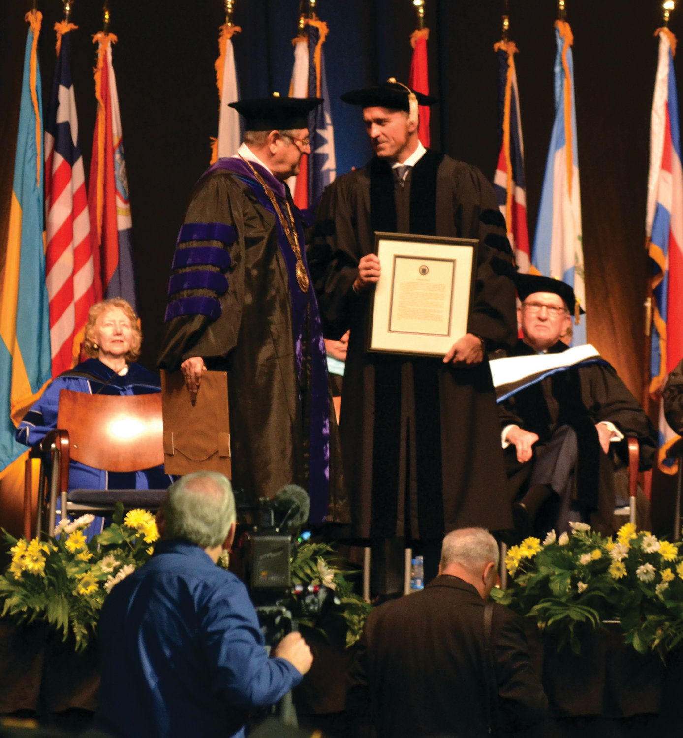 DR. HERREN: NEIT President Richard I. Gouse (left) presented Chris Herren (right) and Donald R. Sweitzer with honorary doctor of humane letters degrees.