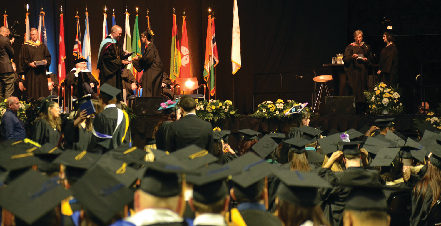 MOMENT THEY'VE WAITED FOR: Graduates received their diplomas after the conferring of honorary degrees and Herren's commencement speech.