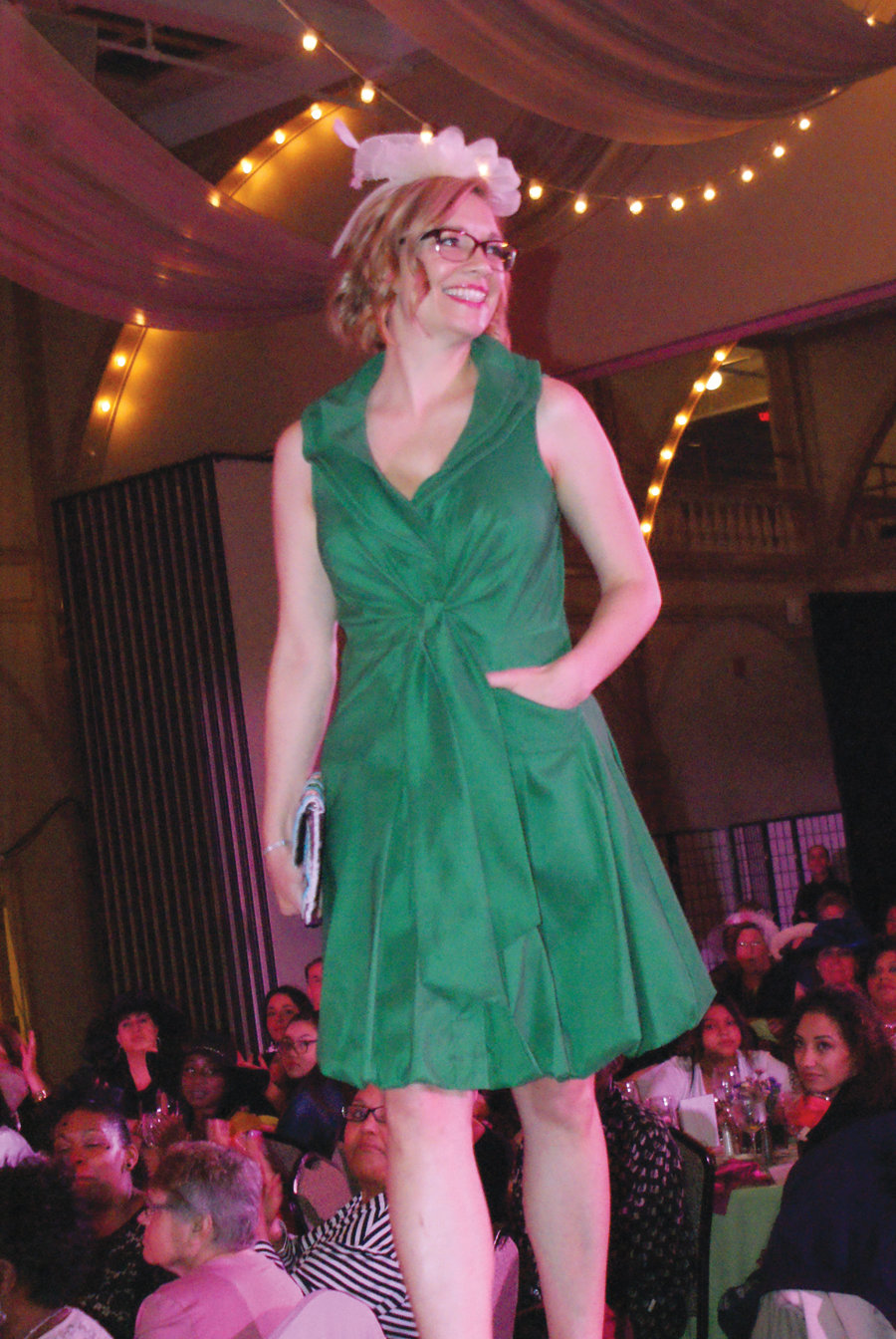 "CLASSIC LOOK: Tonya McBride took to the runway during the ""Our Heroes Fashion Show"" to benefit the Gloria Gemma Breast Cancer Resource Foundation. She is an avid runner and has a goal of running a half marathon in every state."