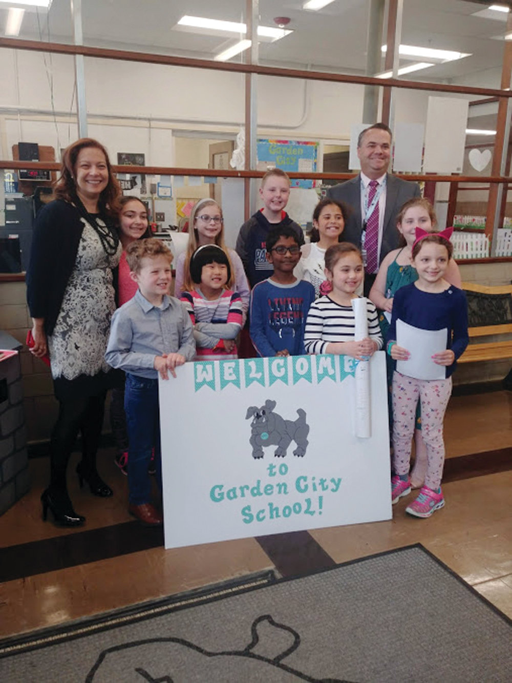 WELCOMING COMMITTEE: Angélica Infante-Green, Rhode Island's new education commission, poses with Garden City Principal Bryan Byerlee and the student representatives who welcomed her to the school.