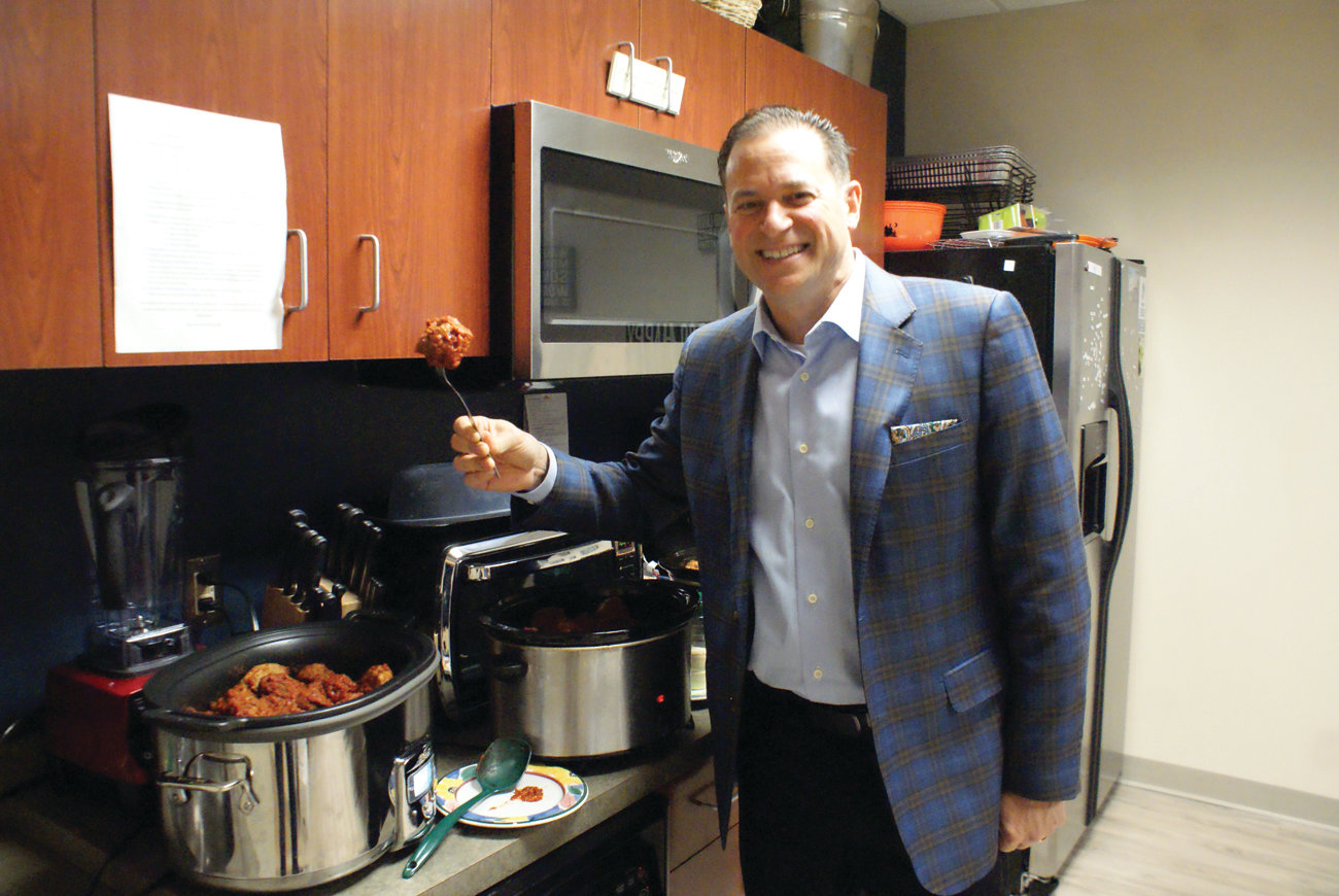 ONLY THE BEST: Michael Andreozzi, CEO of Beltone New England, is sure that his employees start the workweek the correct way – with meatballs every Monday morning.