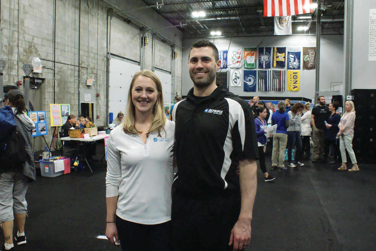 PICTURE OF HEALTH: Olympia Fitness & Performance owner Stephen Zarriello and his wife, Amanda, owner of Restore Physical Therapy, share a moment together during the fair