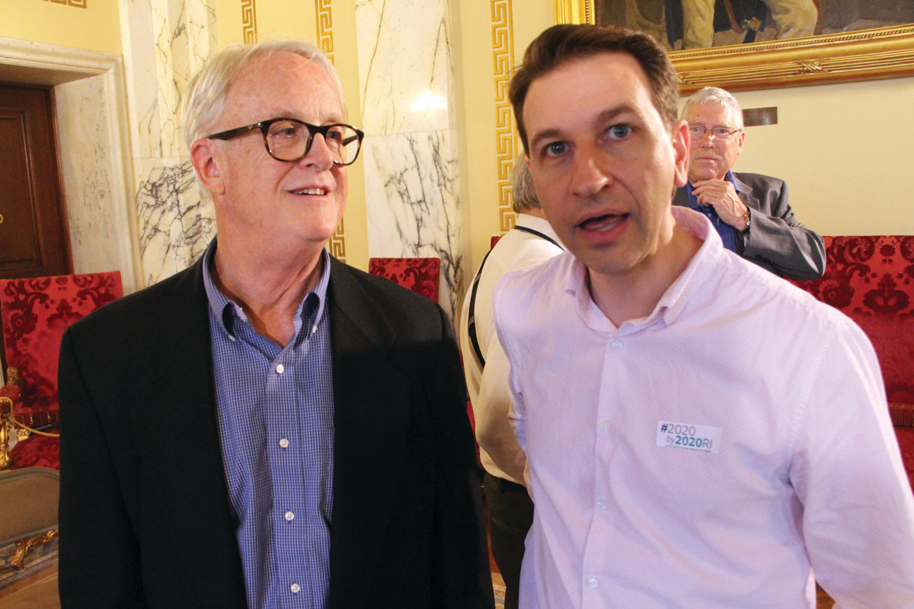 "IN GOOD HANDS: Marc Archambault, who is in the early stages of Alzheimer's disease, talks with Bill Menard of Butler Hospital Tuesday at the State House. Archambault said his decision to reach out to Butler ""was the best thing I did."""