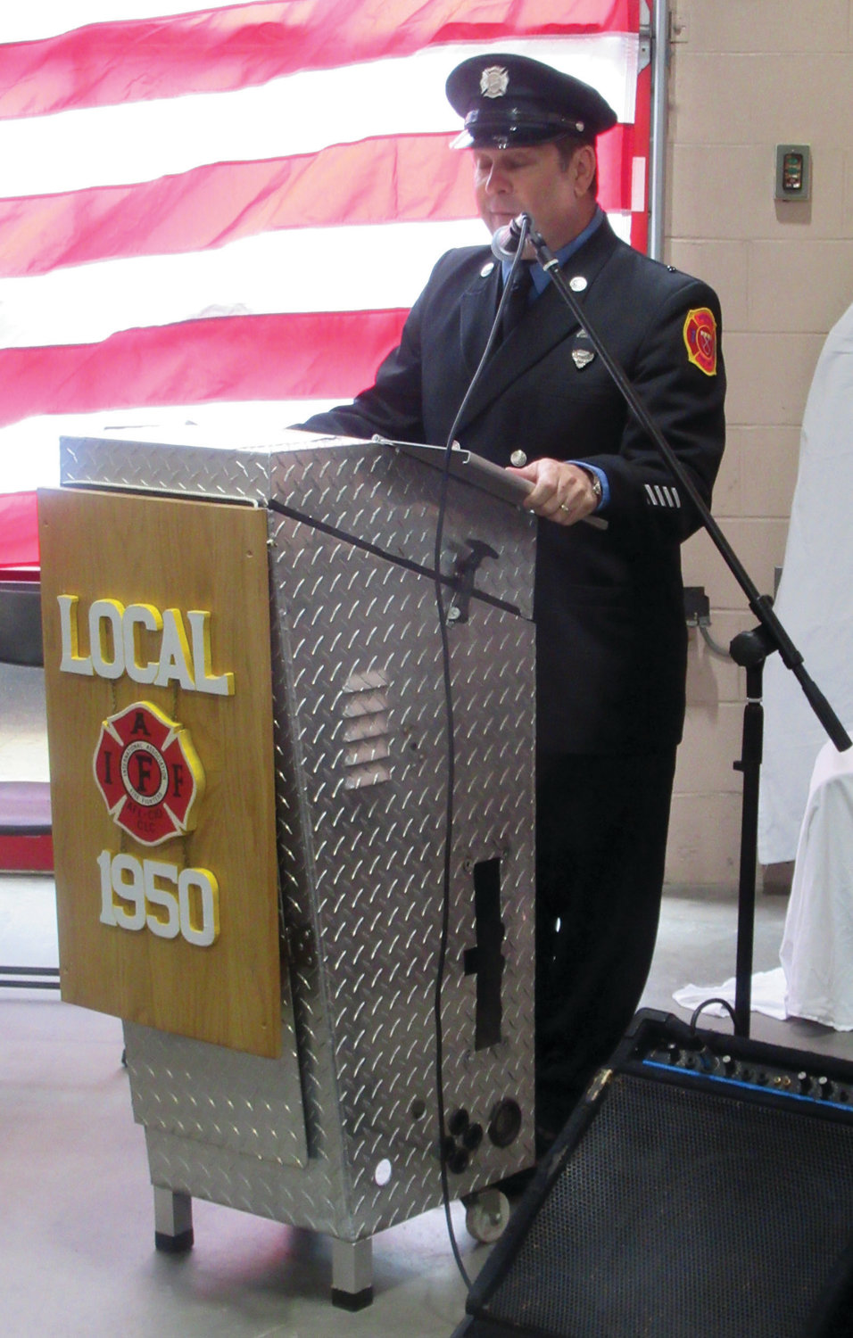 HUMBLE HOST: Dave Pingitore, general secretary-treasurer of Local 1950, served as emcee for Sunday's moving memorial ceremony to honor 19 late members of the Johnston Fire Department.