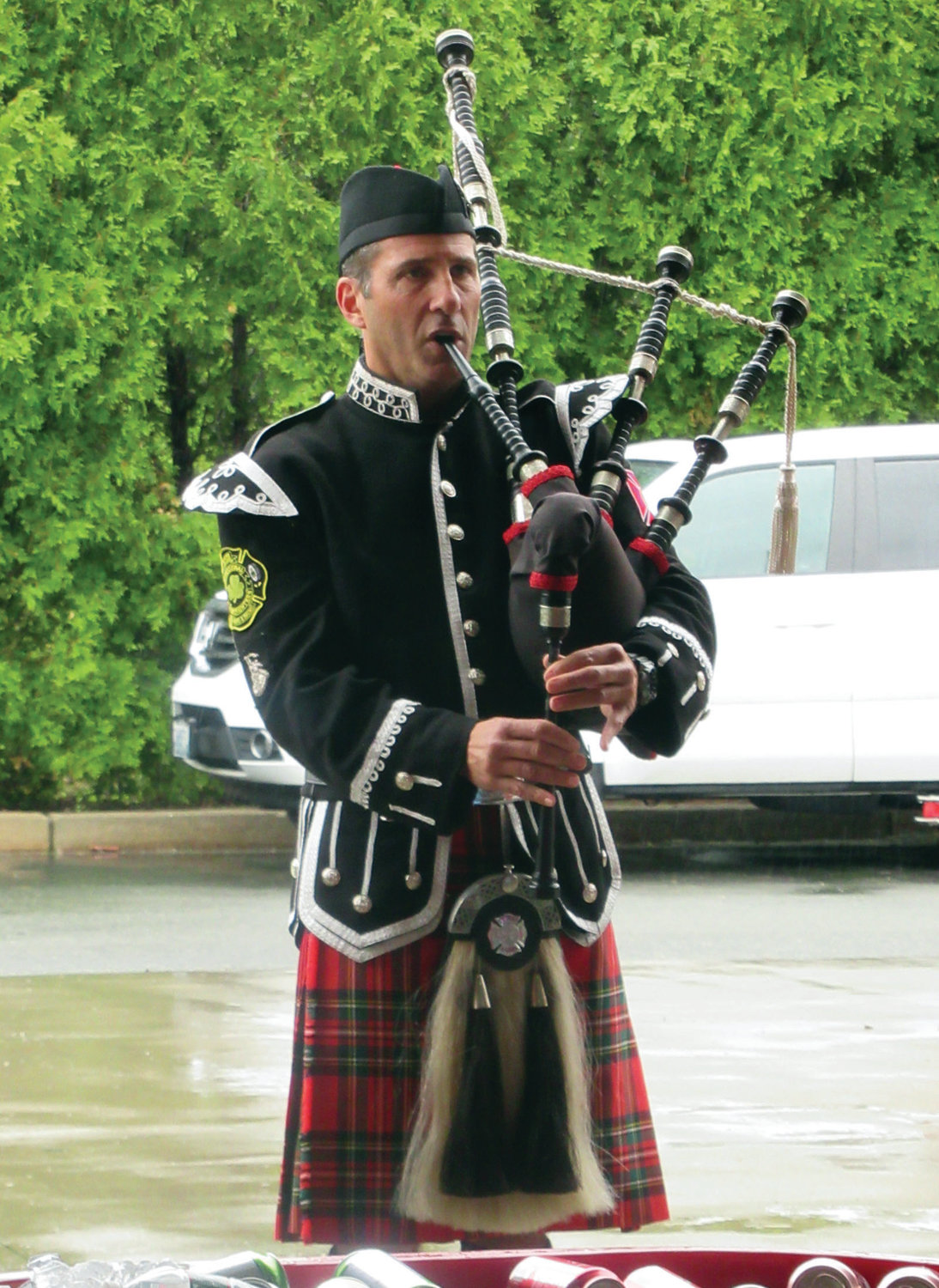 POLISHED PIPER: Retired Warwick Firefighter Carl Pecchia added to the impressive pomp and circumstance of Sunday's Firefighter Memorial Ceremony held inside Station 1 on Atwood Avenue.