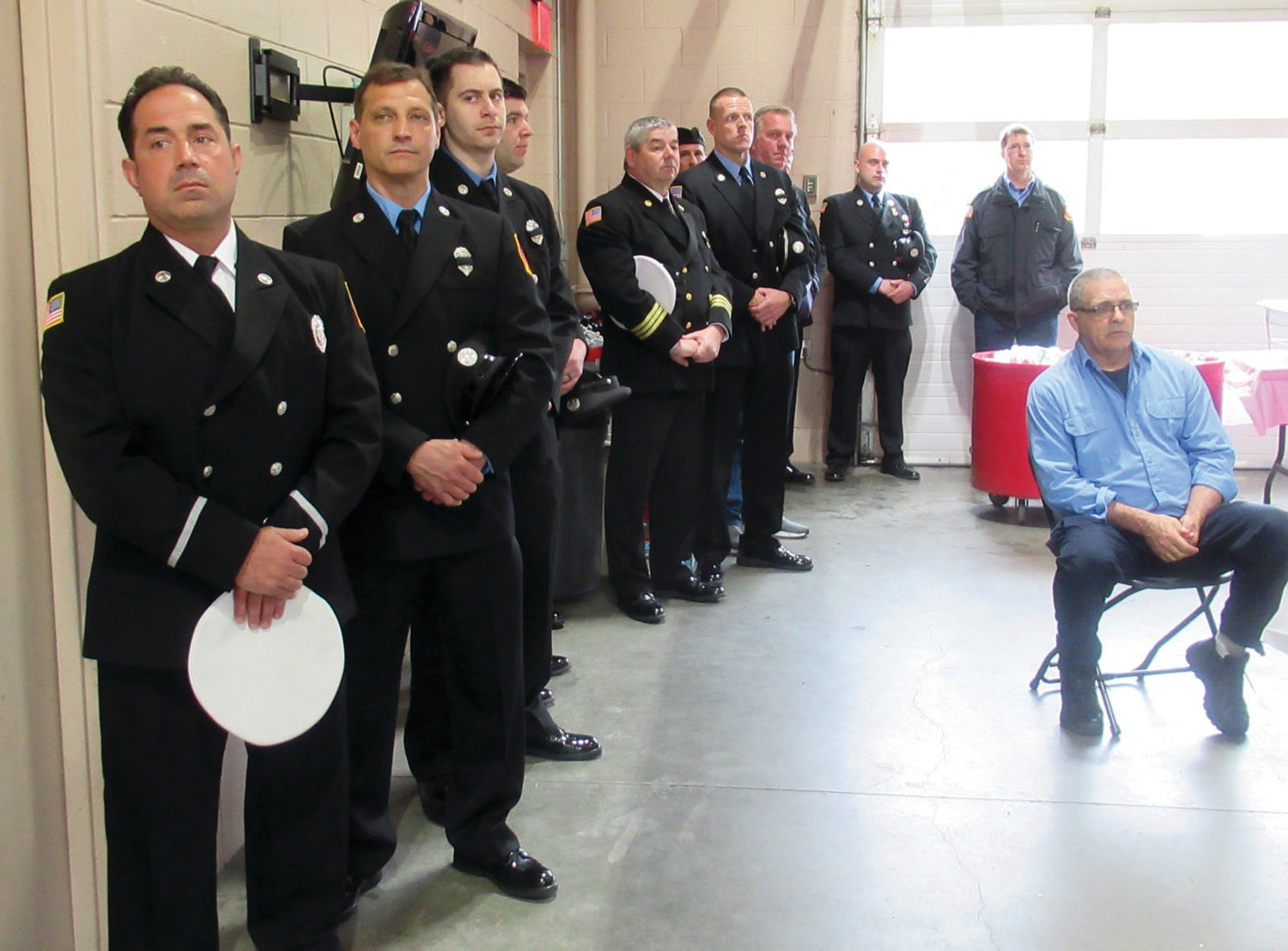 FIRE FORCE: Parade dress was the order of Sunday for most of the Johnston firefighters who remembered 19 deceased members during a moving memorial ceremony inside Station 1.
