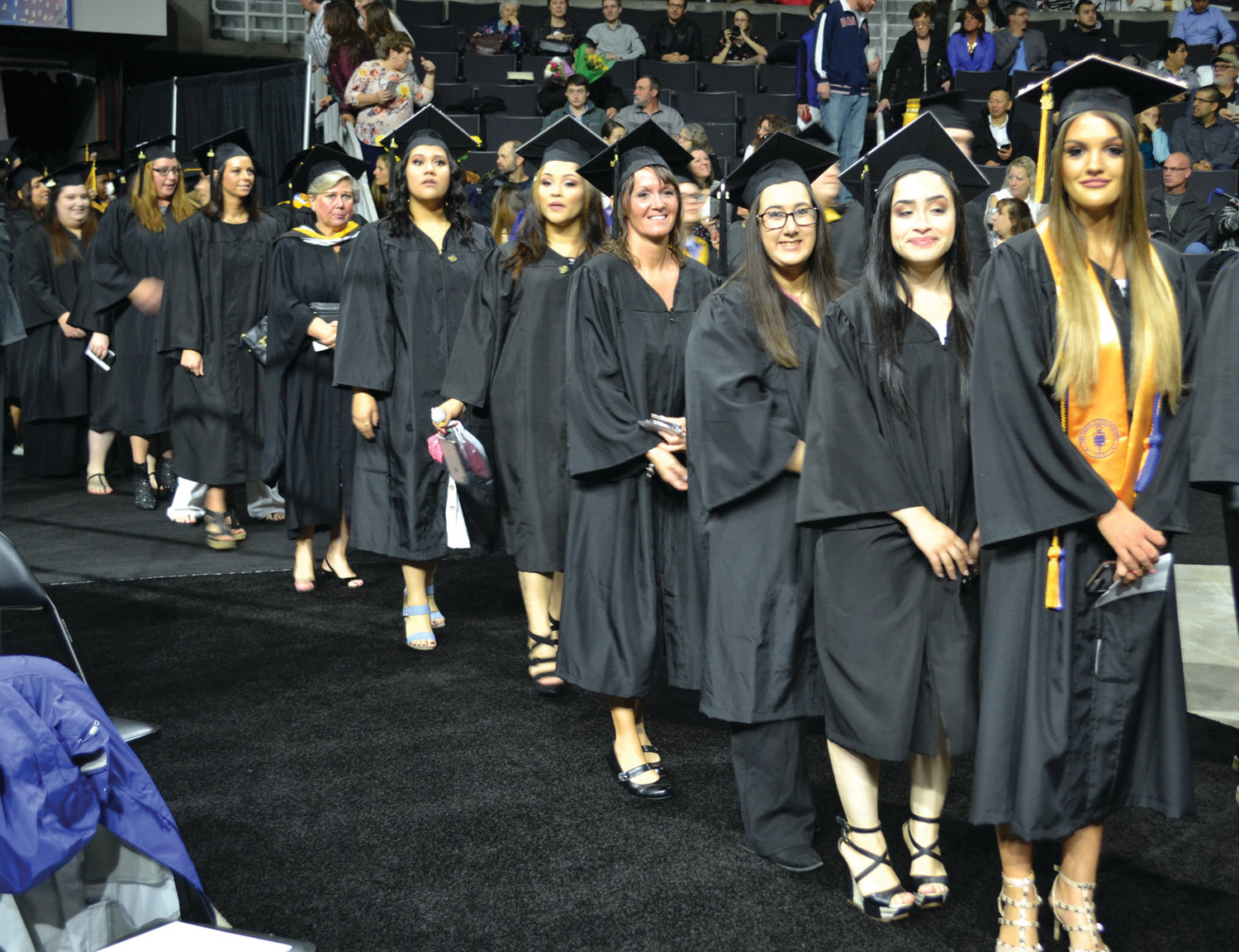 IN THE SPOTLIGHT: New England Institute of Technology graduates made their way into the Dunkin' Donuts Center in Providence on Sunday to the cheers of loved ones in the audience.