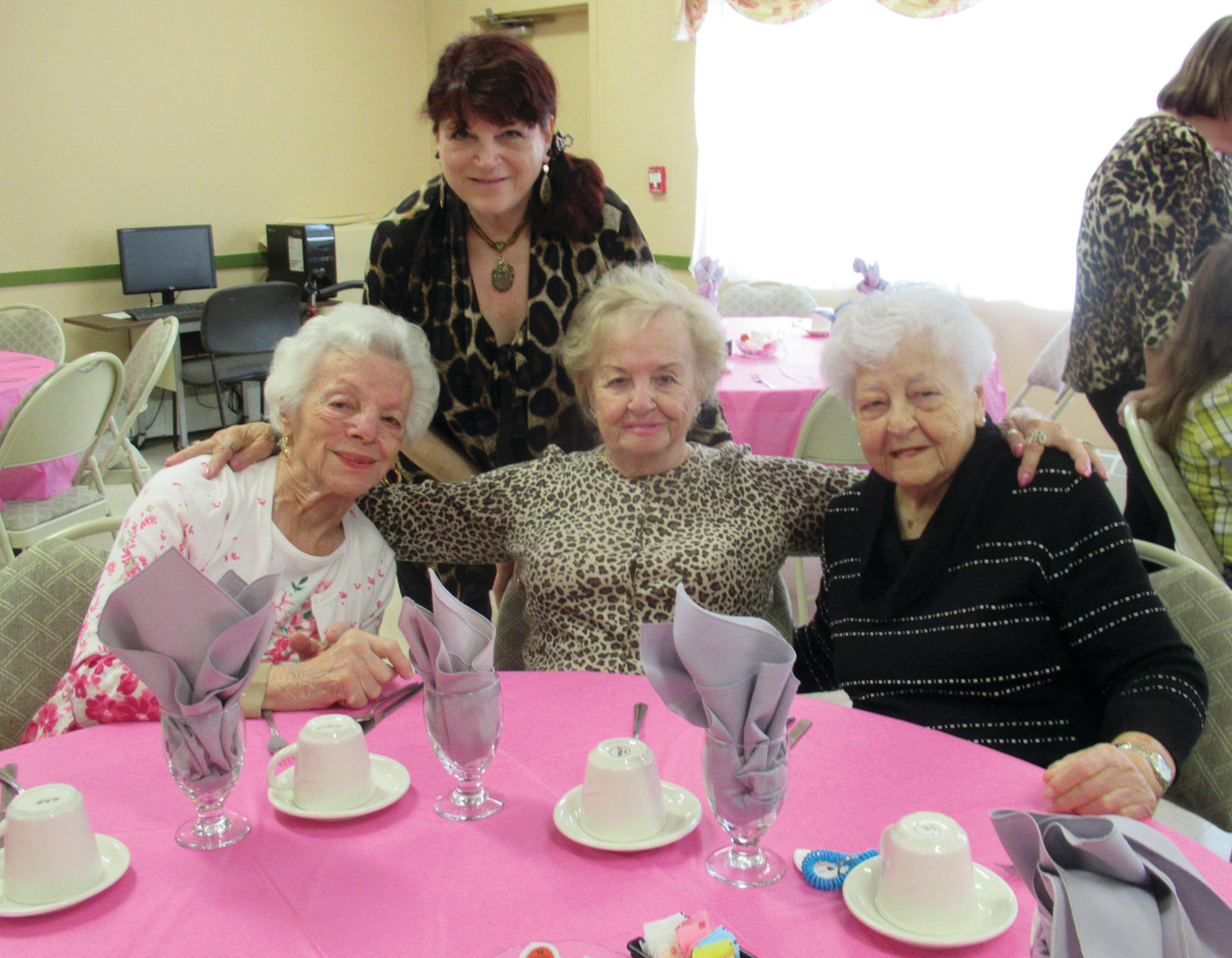 LINDA'S LINK: District 1 Town Councilwoman Linda Folcarelli chats with Pell Manor residents (from left) Etta Marrocco, Alice Perrotti and Josephine Pursche at last week's May Breakfast.