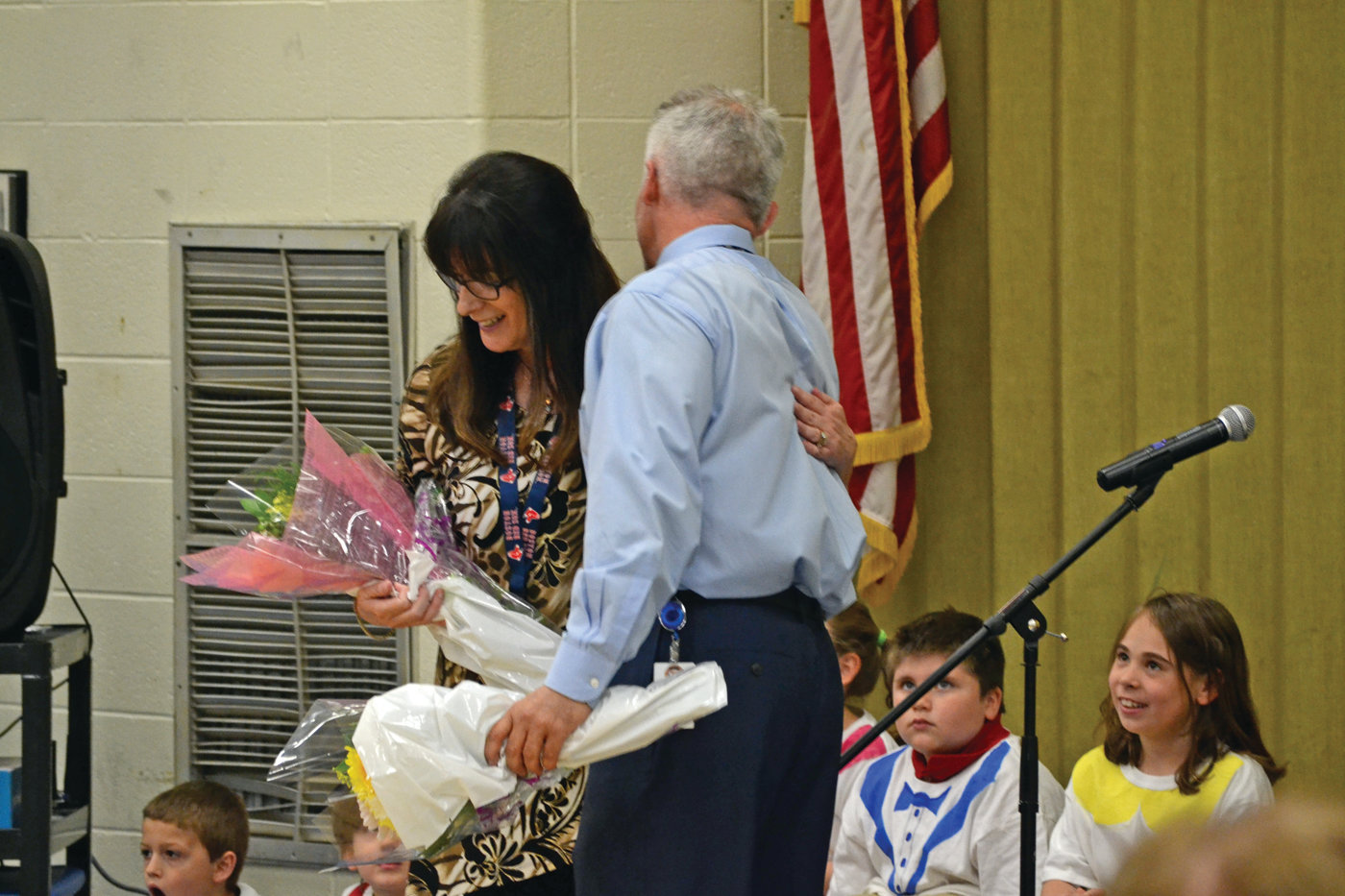 FLOWER POWER: Principal Gary McCoombs gives flowers to Meredith Andreozzi following the performance.