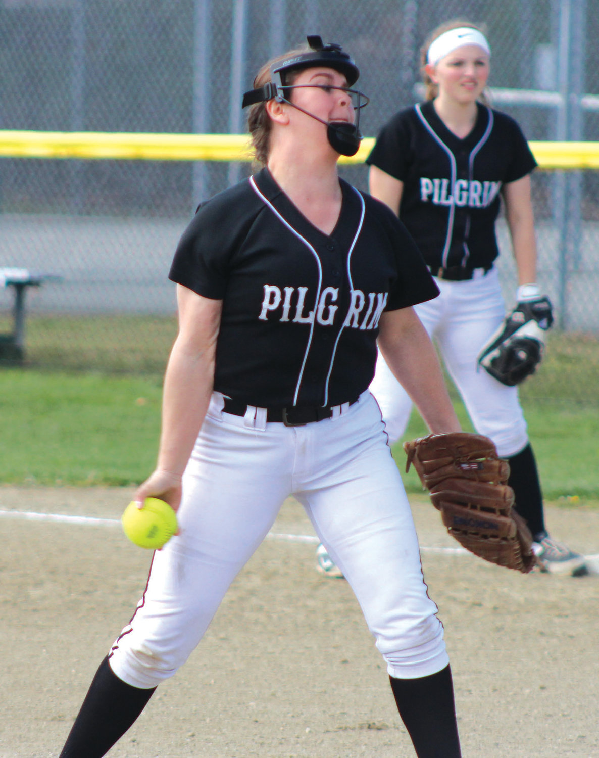 IN THE CIRCLE: Pilgrim pitcher Emily Carter delivers against Mount St. Charles.