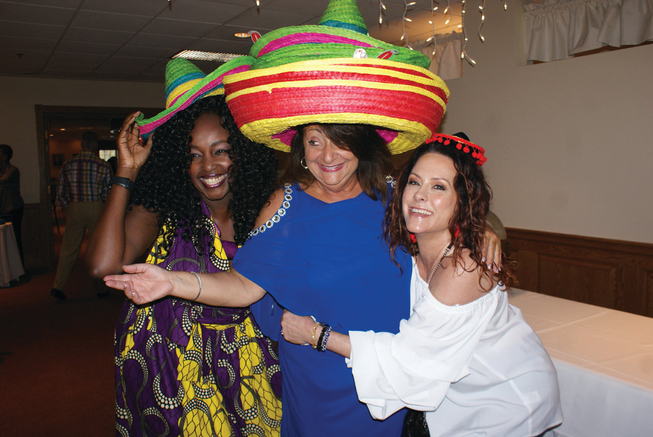 FIESTA: On May 5, Caroline Caprio, center, organized a benefit for the Rhode Island Brain and Spine Tumor Foundation. She is pictured with emcee Mary Gwann and supporter Kim Sacco.