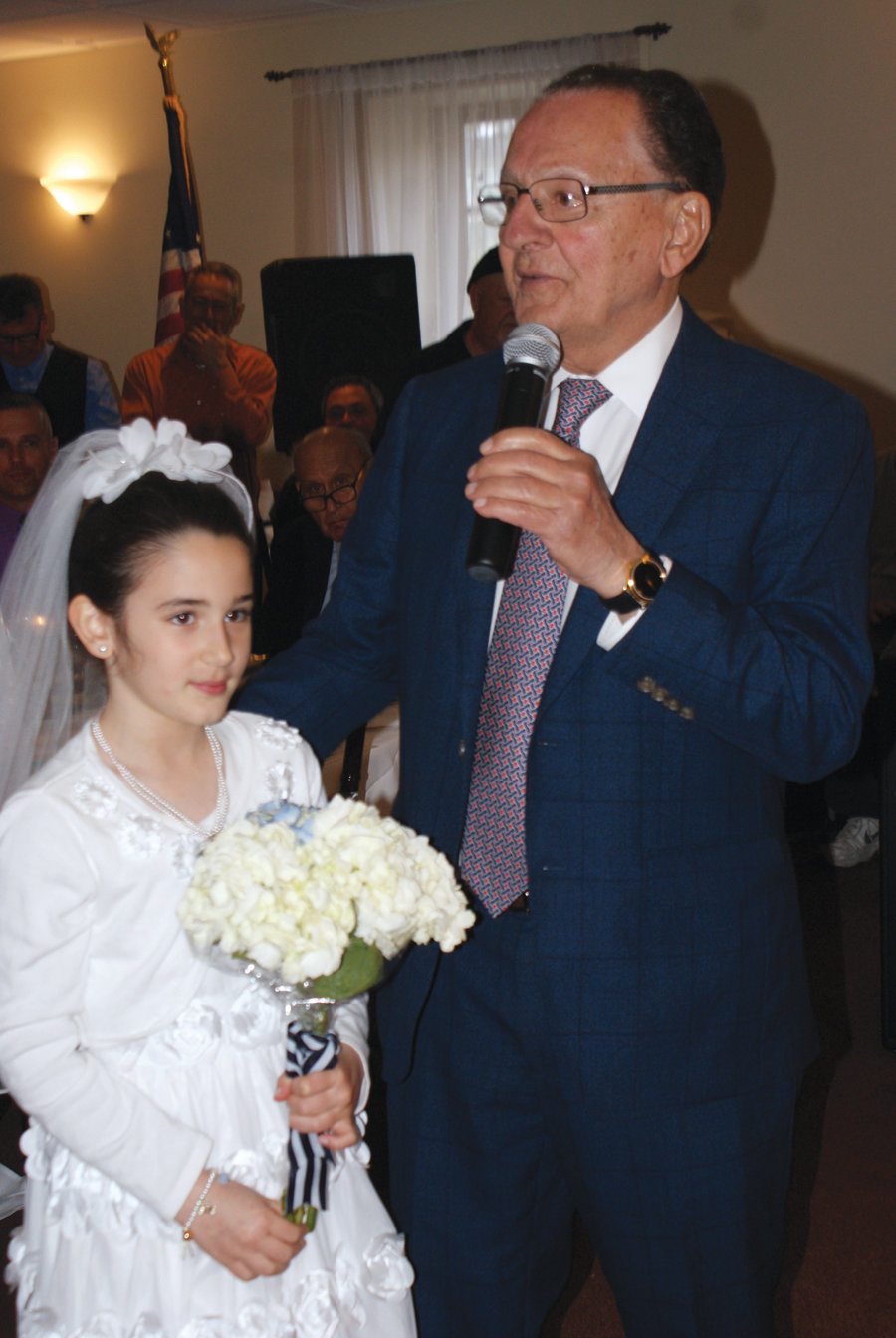 IN THE FAMILY: The keynote speaker for the event was Frank Caprio, Caroline Caprio's cousin and chief judge of Providence Municipal Court. He is pictured with his 9-year-old granddaughter, Francesca Pesce.