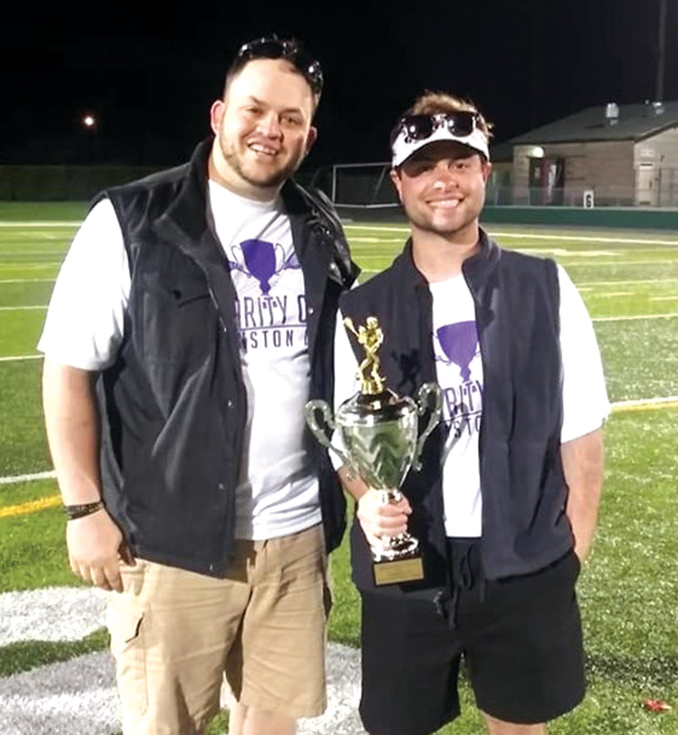 Cranston West head coach Justin Erickson and co-head coach Matt Pagnozzie celebrate the team's Border Cup victory over Warwick at Cranston Stadium last weekend.