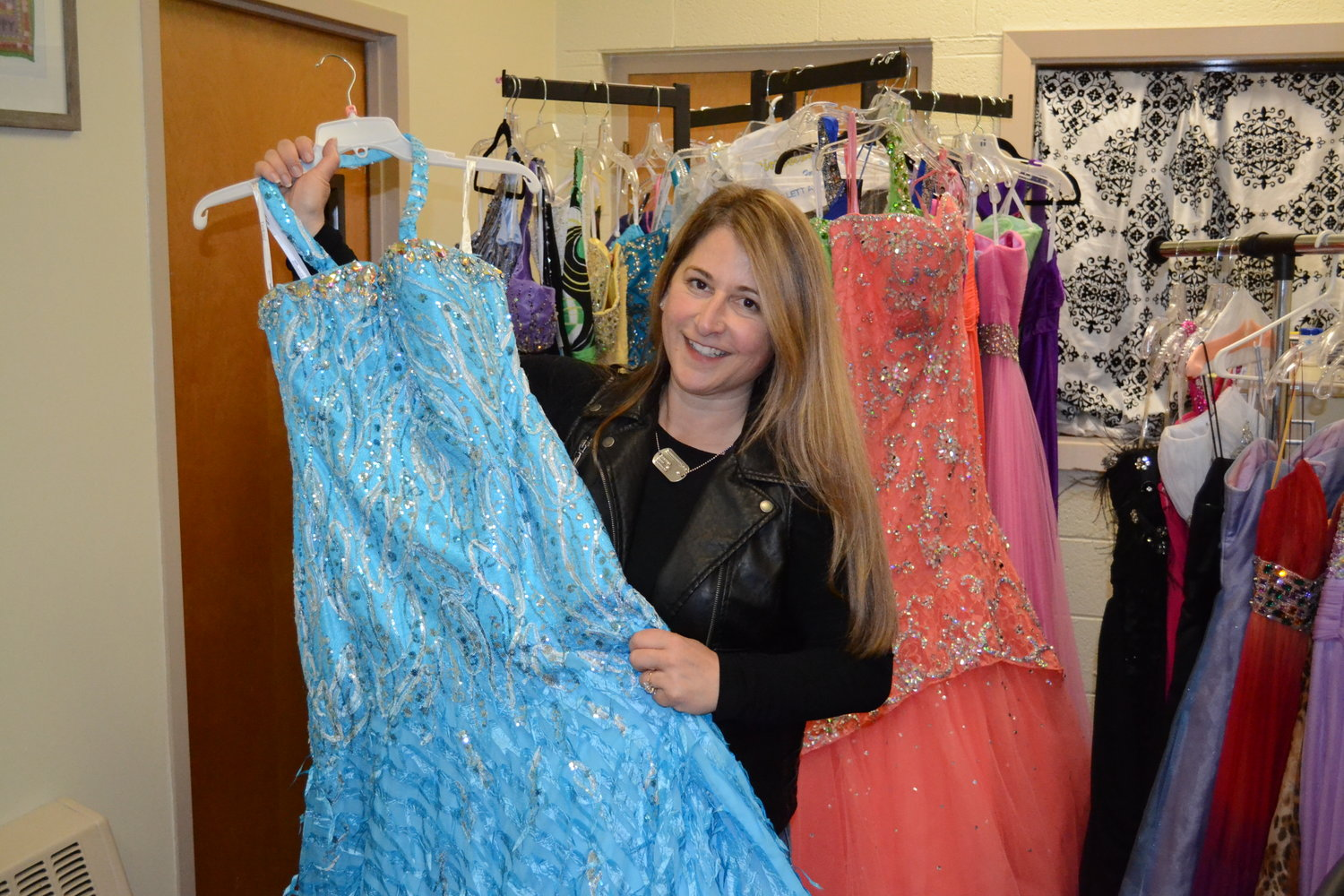 PURVEYOR OF PROM: Heidi Fanion, school social worker, has over 50 dresses in every size and style imaginable available to students for free, just in time for prom.