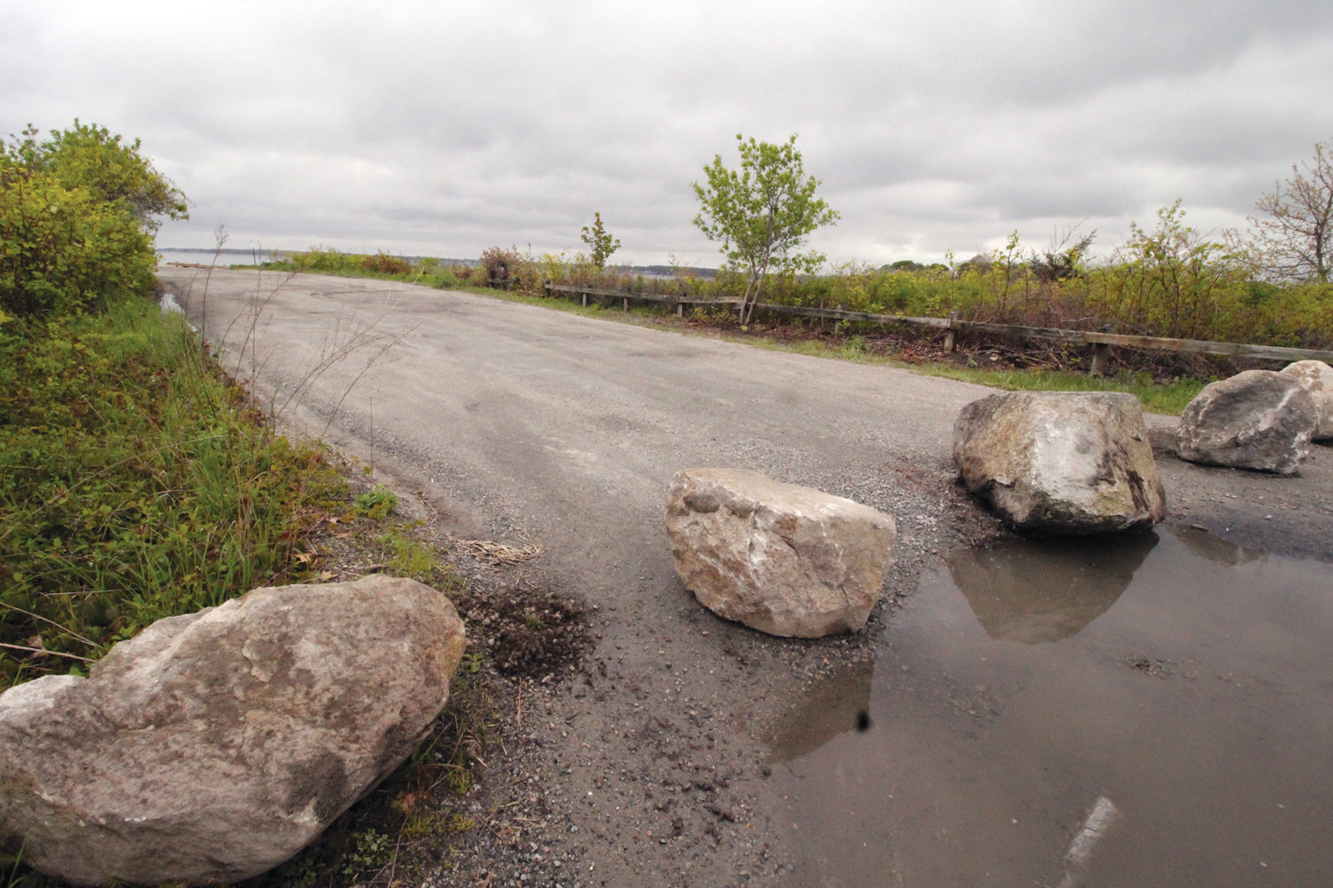 HERE ON TUESDAY, GONE WEDNESDAY? The city Department of Public Works placed boulders to block the entrance to the Seaview Drive parking lot in Oakland Beach Tuesday morning. On Wednesday afternoon, Councilwoman Donna Travis said the rocks would be removed pending a public hearing.