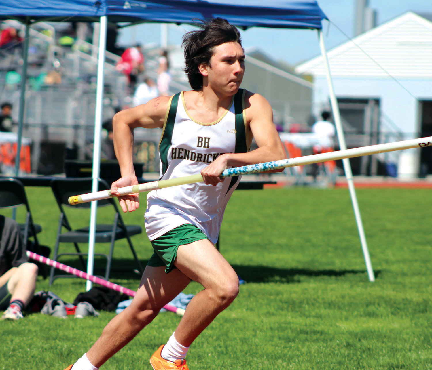MAKING THE JUMP: Hendricken's Matt Froehlich competes in pole vault.