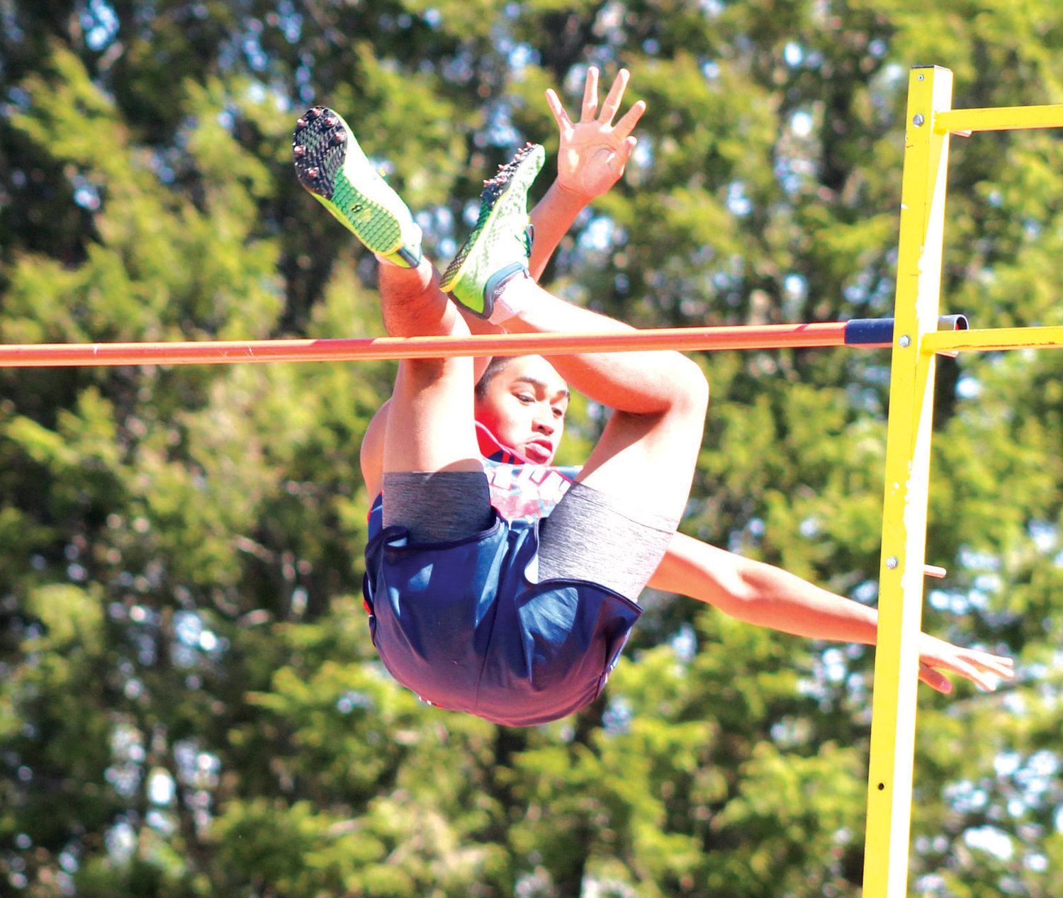RAISING THE BAR: Toll Gate's Elijah Aguilar clears the bar during the pole vault competition at the Sgt. Brian St. Germain Invitational in West Warwick over the weekend. Aguilar took 12th place in the event, which was the last competition prior to this weekend's class championships in Coventry.