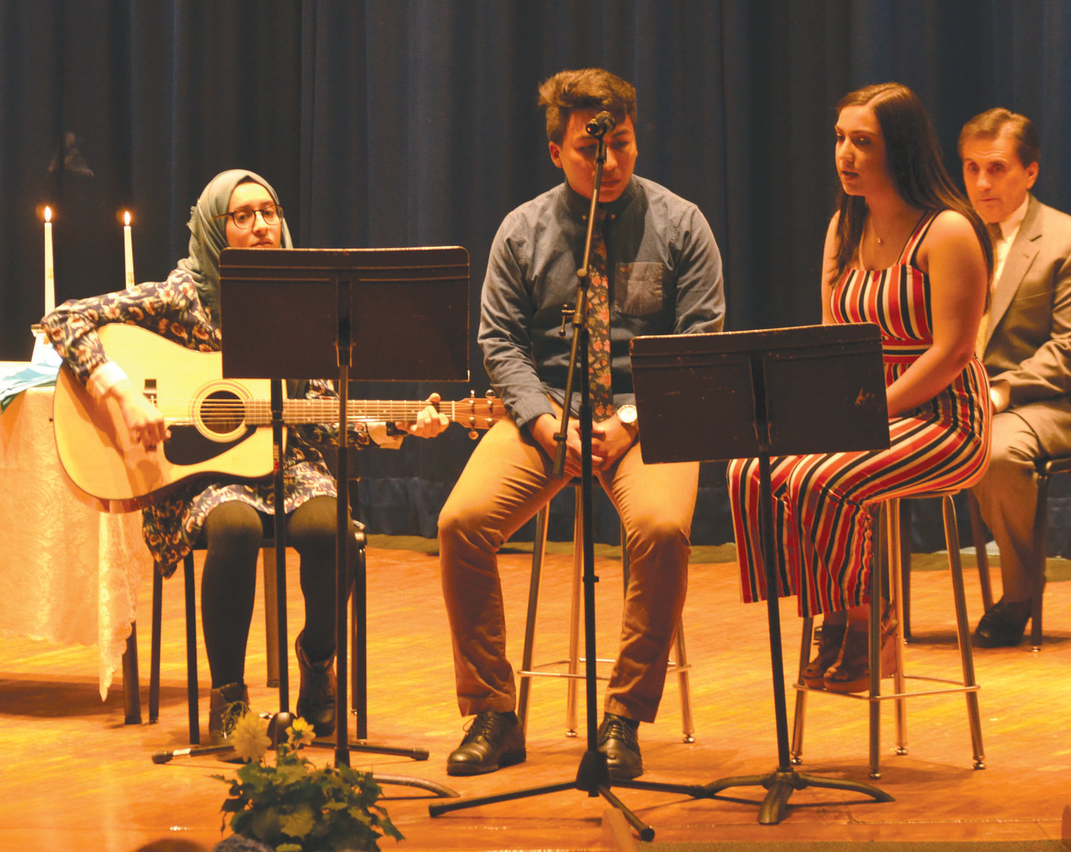 Haya Abaherah, Daniel Cambranes and Isabella Parrillo performed a musical selection.