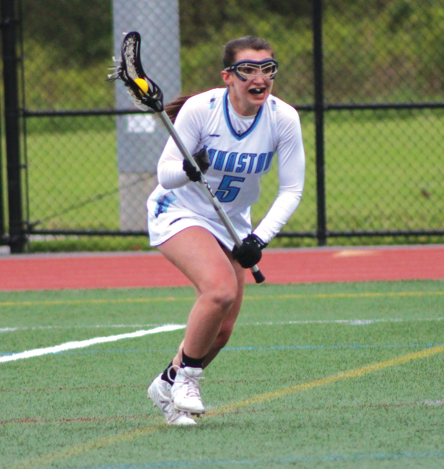 UP THE FIELD: Johnston girls lacrosse captain Gabby DiRaimo carries the ball up the field against Westerly.