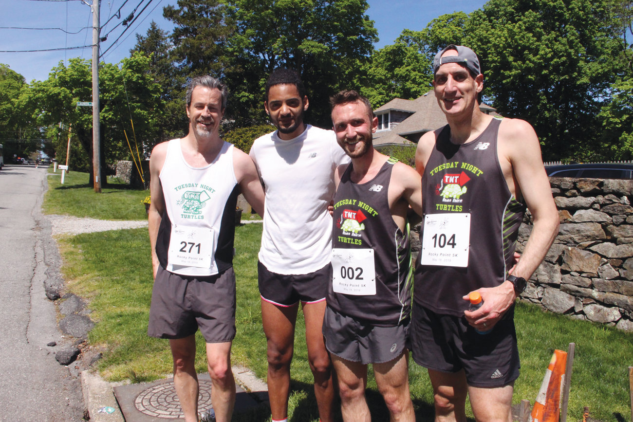 HARD TO CATCH: Members of the Pawtuxet-based Tuesday Night Turtles, who run year-round, swept top finishers for the 5K. From left are fifth-place finisher Andrew Goodale, first-place finisher Bronson Zvenable with a time of 16:58, second-place finisher Greg Motta and third-place finisher Robert Corsi.