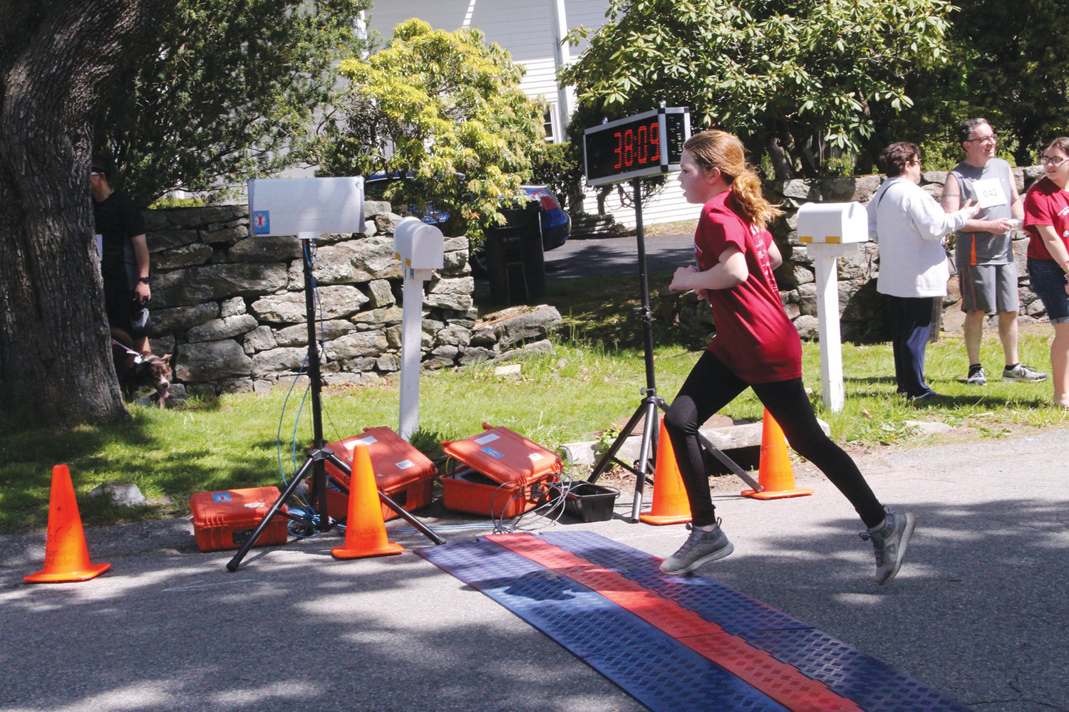 SPRINT TO THE FINISH: Madeline Faucher puts in a final effort as she crosses the finish line.