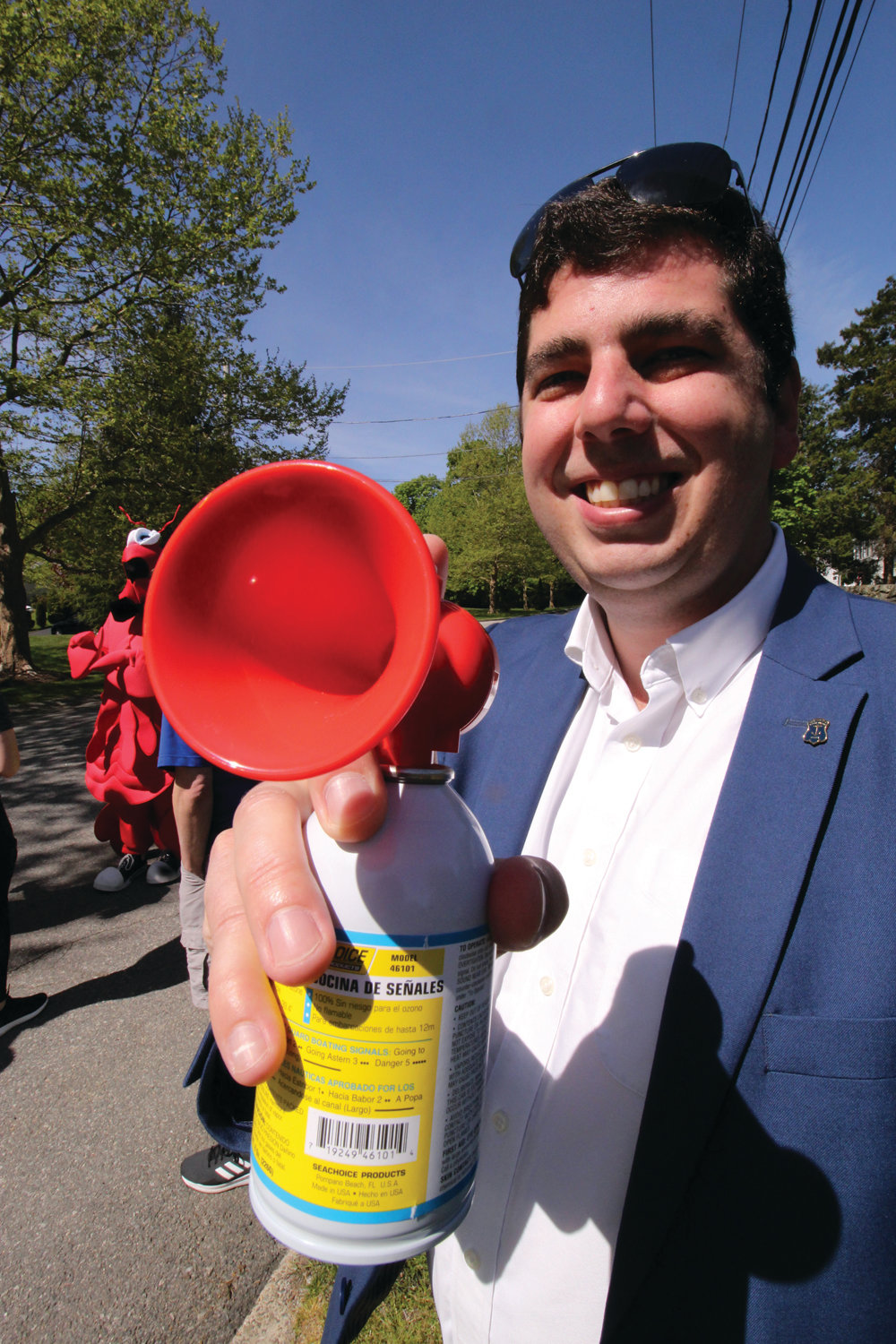HE HAD A BLAST: Rep. Joseph Solomon Jr., whose district includes Rocky Point, blew the air horn to send 286 runners and walkers on the course.