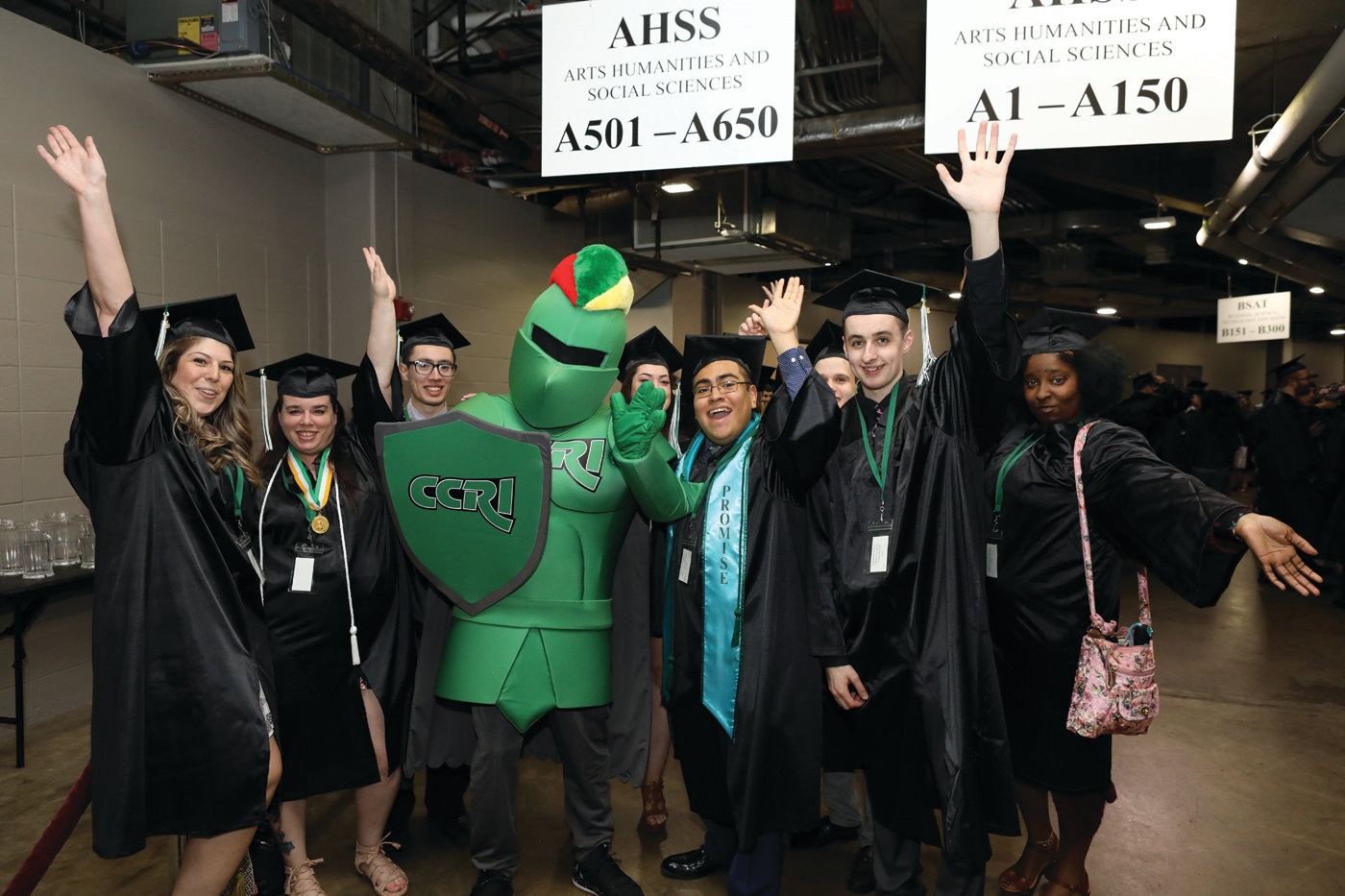 PROUD KNIGHTS: Members of CCRI's graduating class share a moment with the school's mascot ahead of the May 16 commencement ceremony at the Dunkin' Donuts Center.