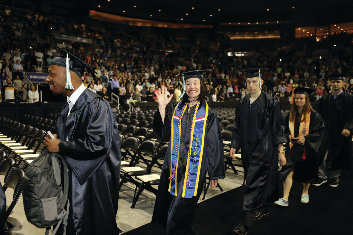 REASON TO SMILE: CCRI graduates proceed into the Dunkin' Donuts Center before receiving their degrees during the college's 54th commencement ceremony.