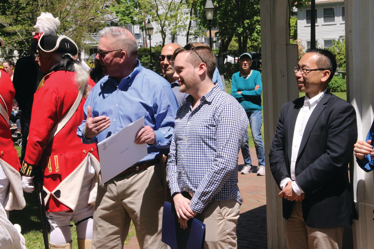 CENTER SPOTLIGHT: Gaspee Days Committee president Ryan Giviens is flanked by Rep. Joseph McNamara and Cranston Mayor Allan Fung during opening ceremonies of Gaspee Days.