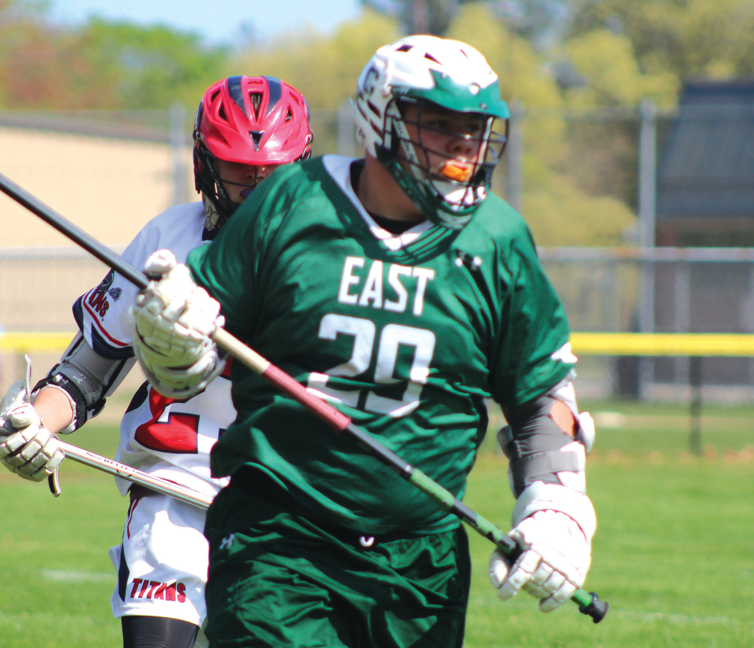 TOUGH DEFENSE: Cranston East defender Omar Reyes carries the ball out of the Toll Gate zone last week when the two clubs squared off at Warwick Vets Middle School. The Titans won 14-11 in a thriller.