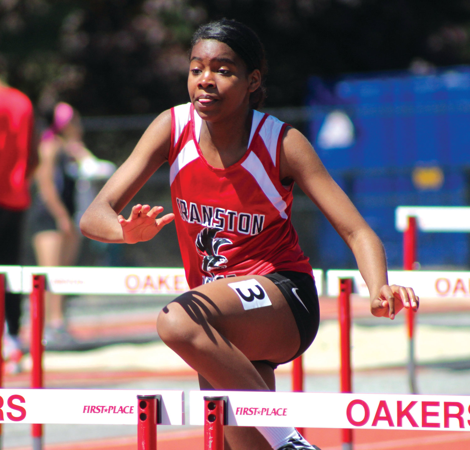 MAKING THE LEAP: Cranston West's Imani Briggs competes in the hurdles.