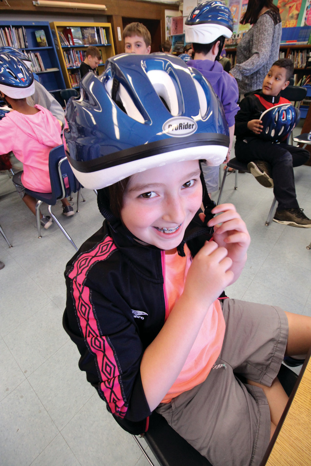 Abigail Swanson proudly shows off her new head gear.