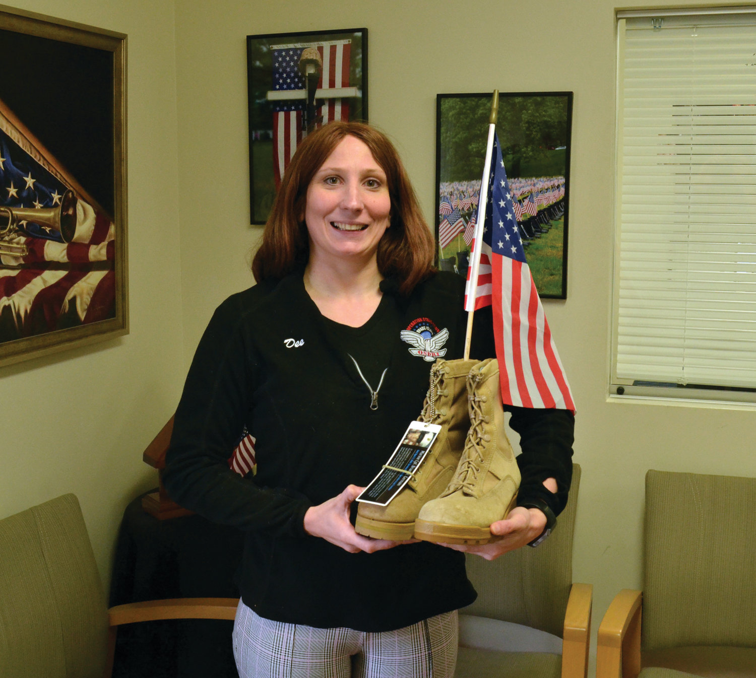 NEVER FORGOTTEN: OSDRI development director and event founder Dee DeQuattro holds one pair of boots that will be seen at this weekend's event.